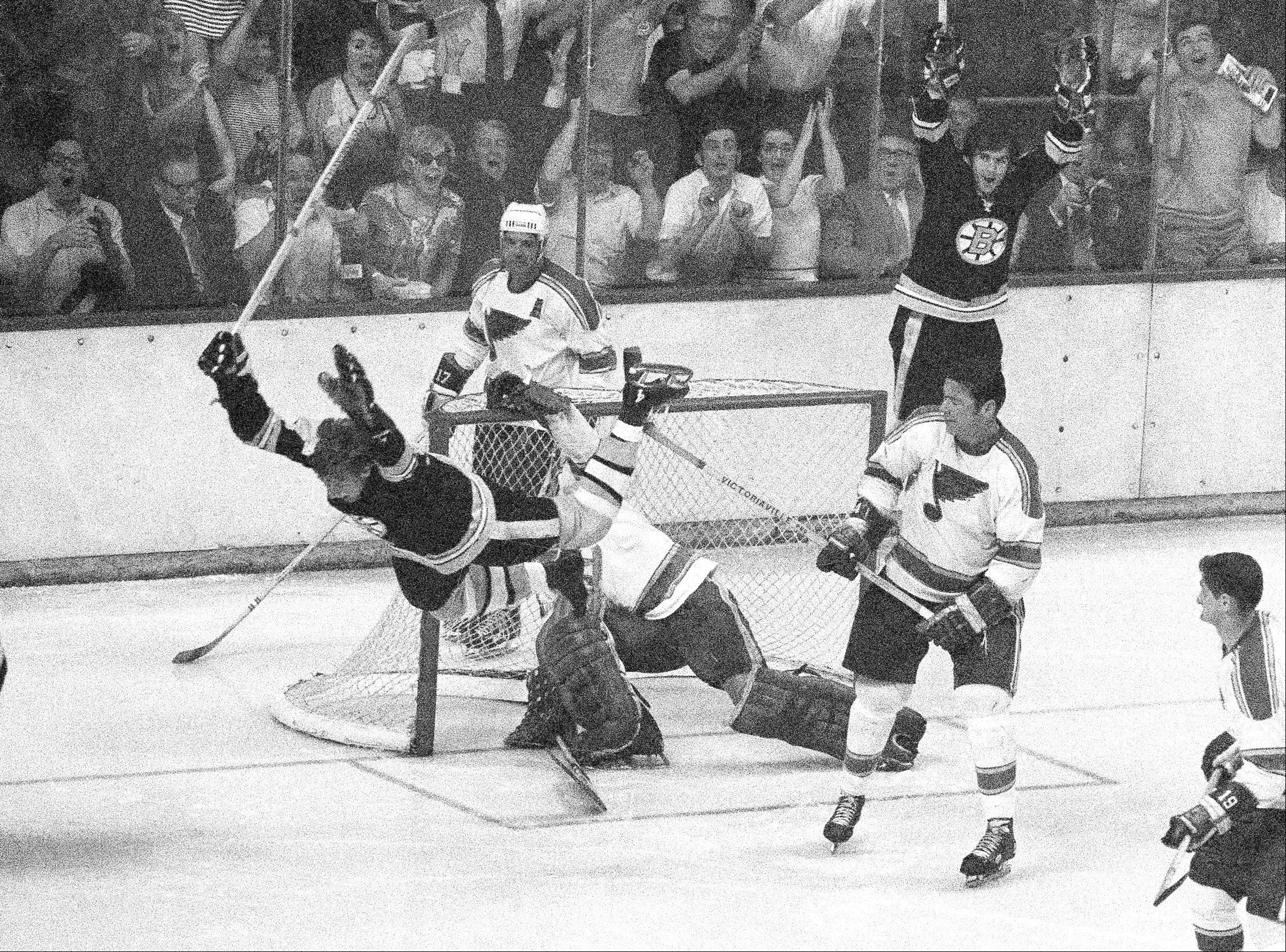 Bobby Orr flies through the air after scoring the winning goal against Blues goalie Glenn Hall in overtime of the Stanley Cup Final. The Bruins won 4-3 and swept the series in four games to capture the Stanley Cup for the first time in 29 years.