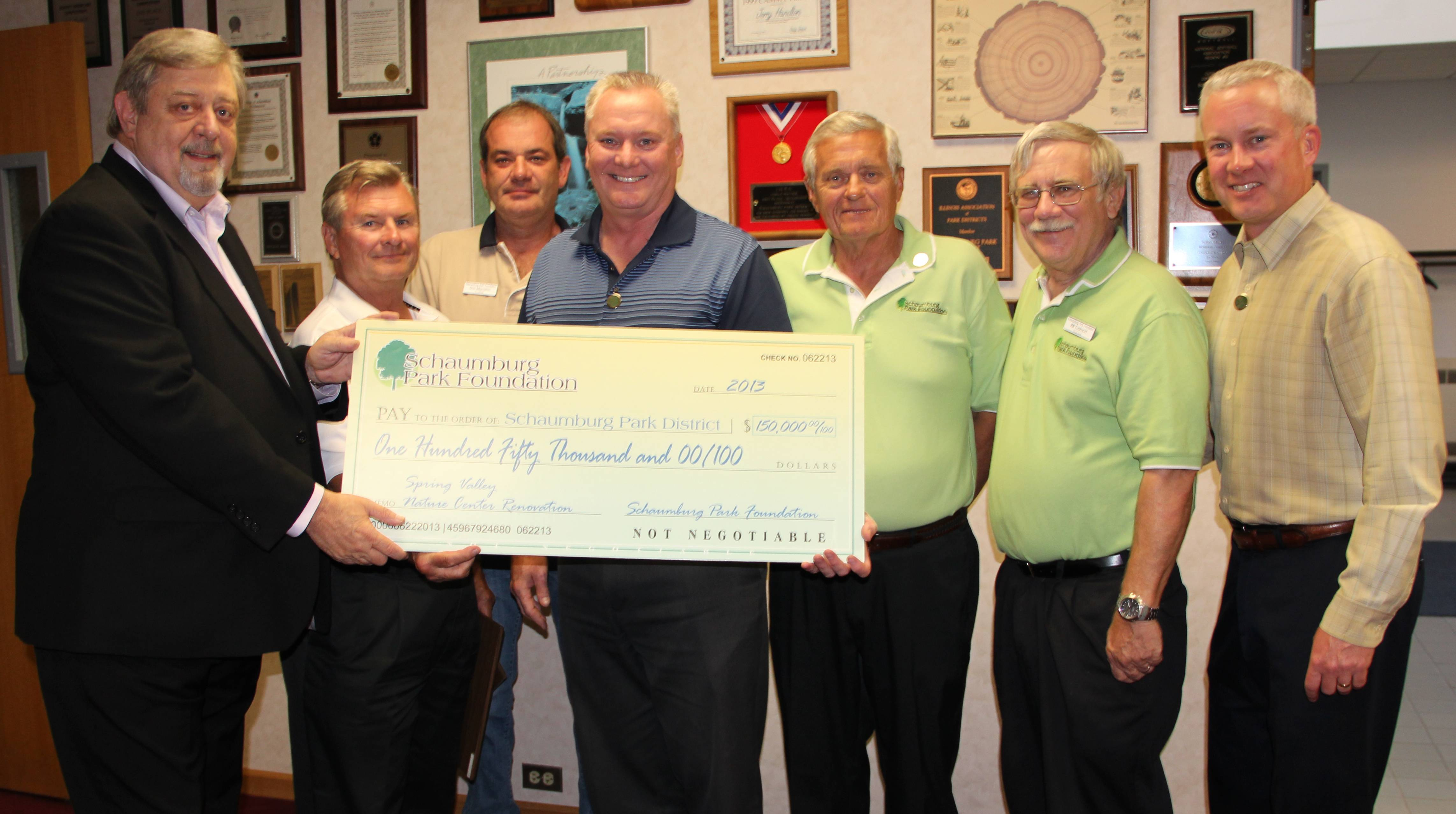 Park Board President Mike Daniels (left) accepts a $150,000 check for the Spring Valley Nature Museum renovations from Schaumburg Park Foundation Board Trustees Glenn Szurgot and Don Morrison, Vice Chairman Brian Bieschke, Trustees Dave Johnson and Bill Tucknott, and President Tony LaFrenere.