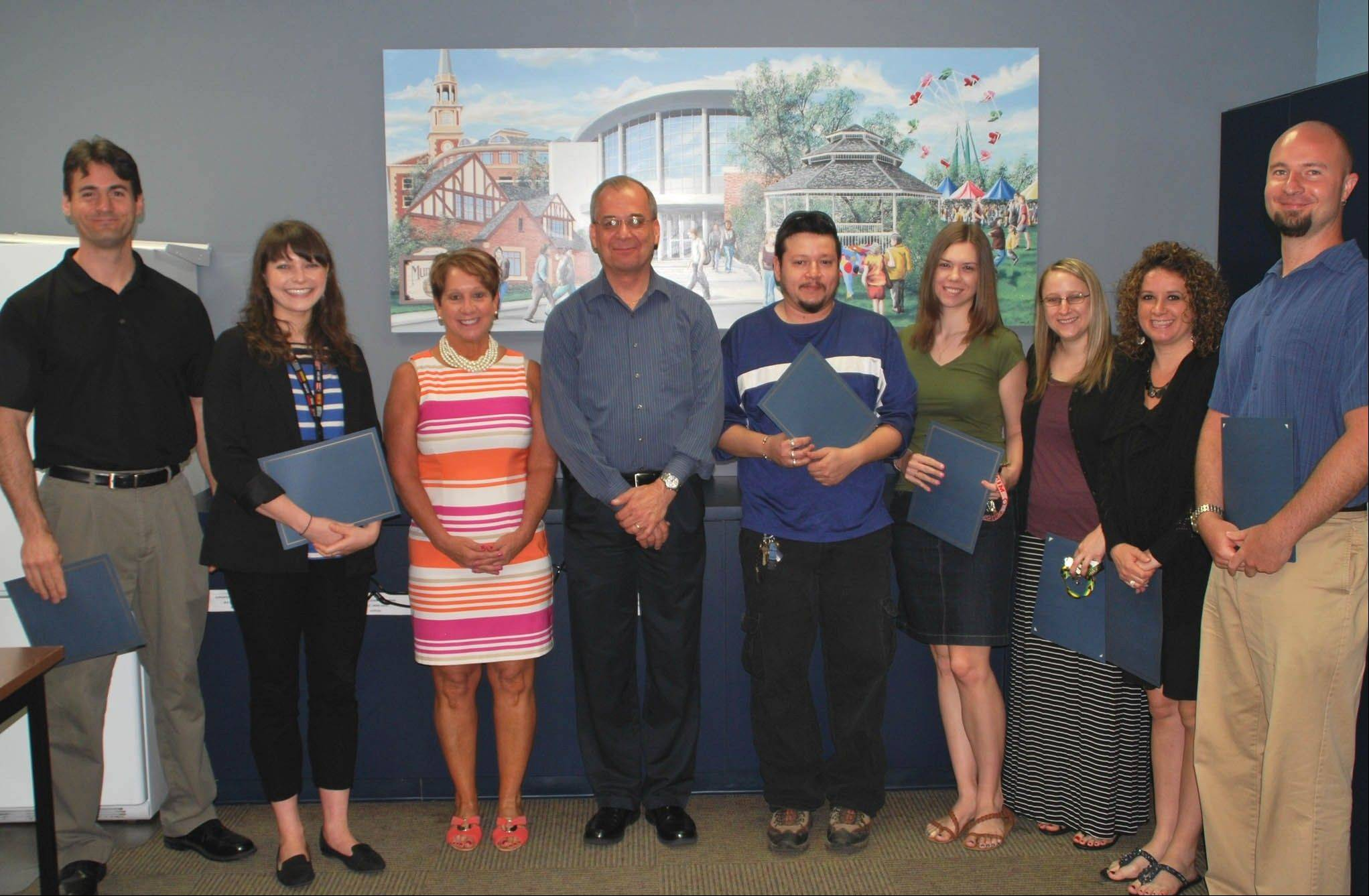 Mundelein High School faculty members, from left, Mike Hickey, Blair Winter, superintendent Jody Ware, Paul Havlik, Rodolfo Cabrera, Katie Giambeluca, Jamie Moderhack, Maureen Baker and Mark Michalski received grants for special projects at a recent ceremony.