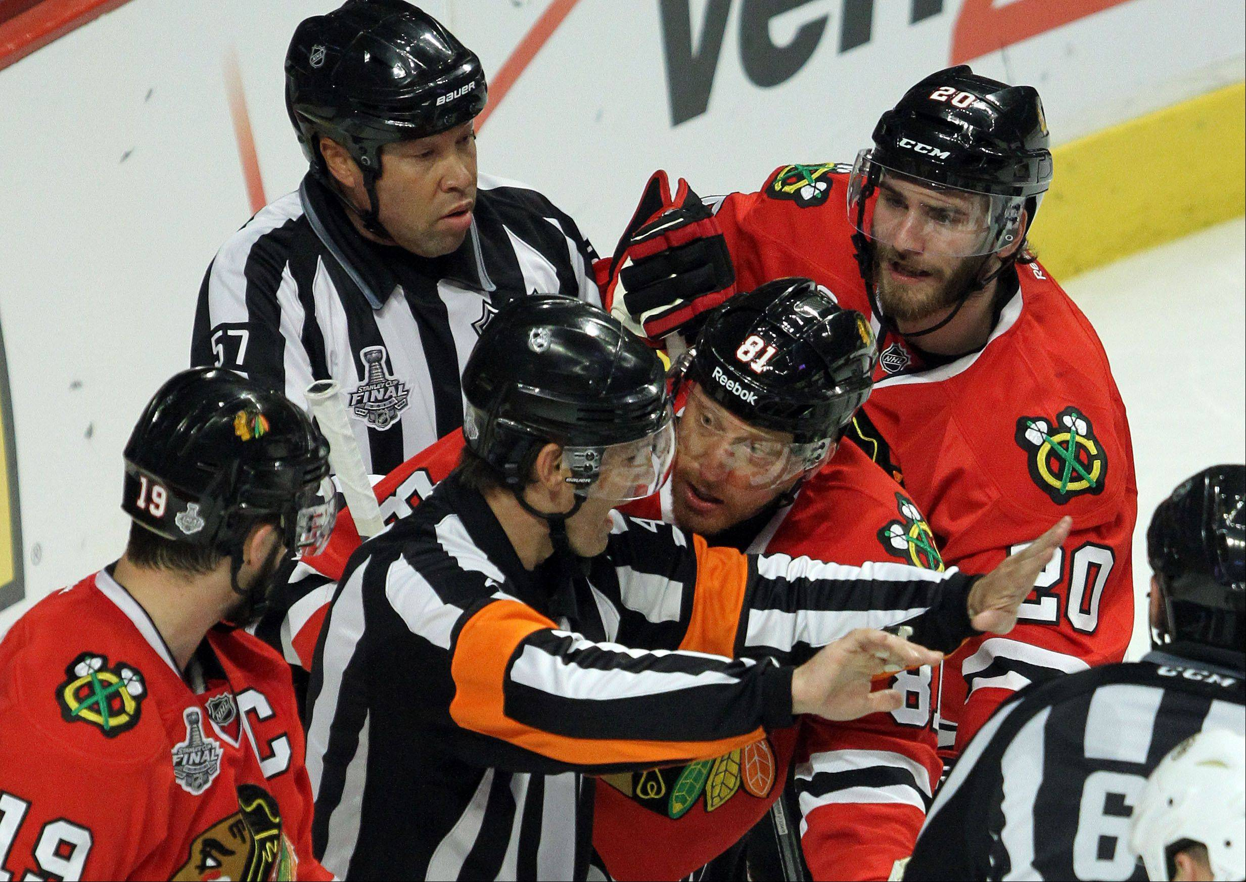 Blackhawks players Jonathan Toews, from left, Marian Hossa and Brandon Saad argue what they thought was a goal in Saturday�s first period at United Center.