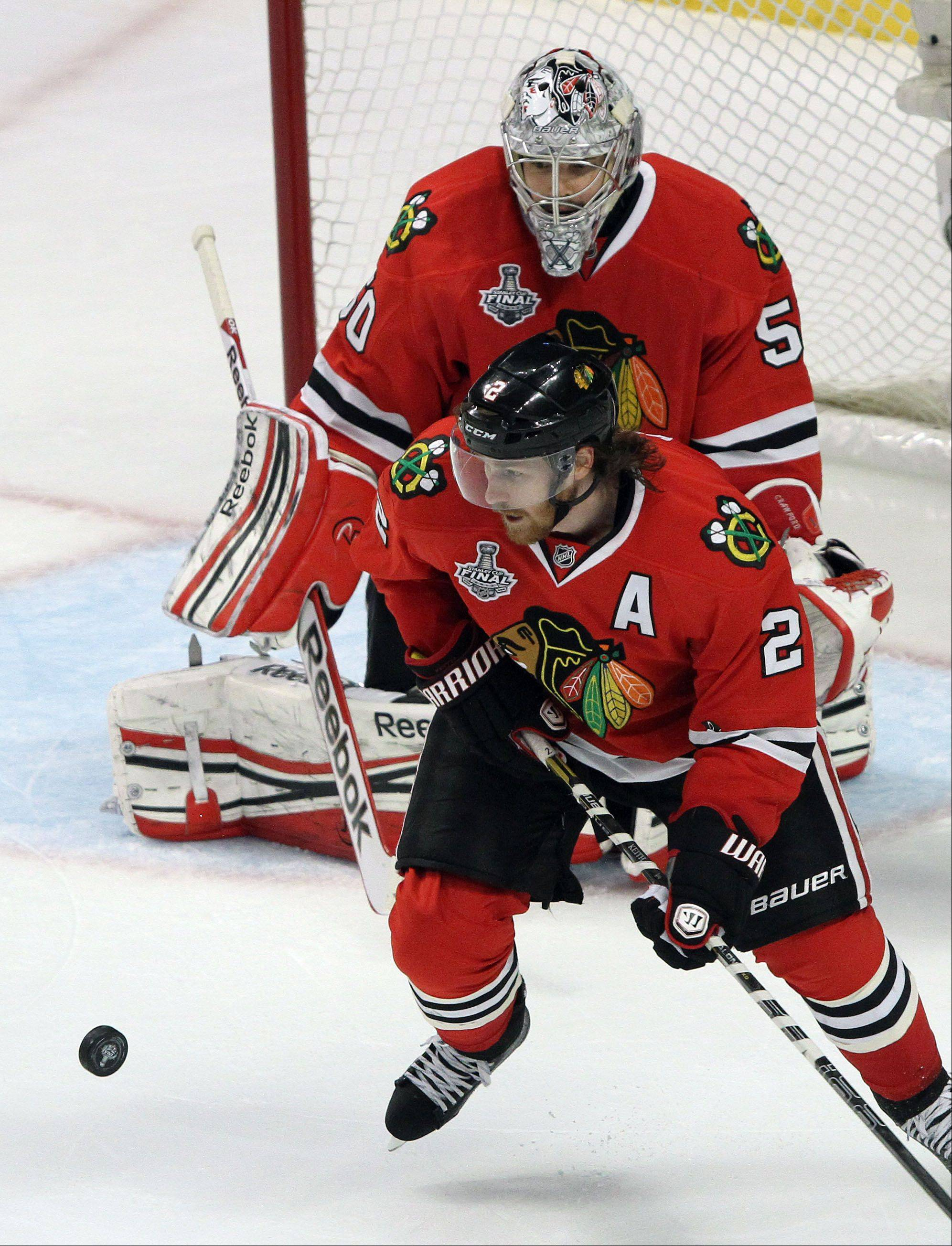 Blackhawks defenseman Duncan Keith, seen here breaking up a play in front of goalie Corey Crawford, logged 32:09 of ice time in Saturday night�s Game 2.