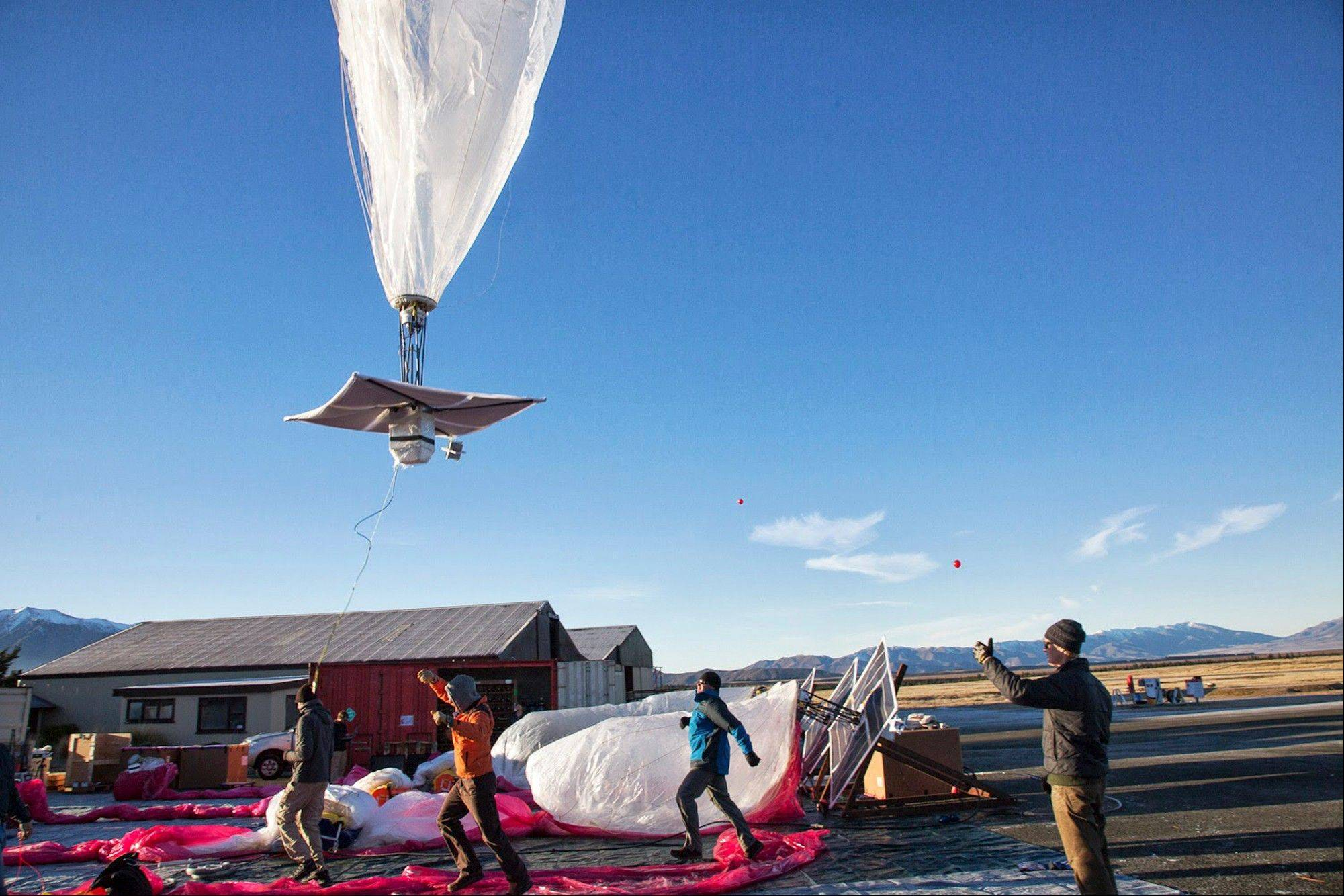 A Google team releases a balloon last week in Tekapo, New Zealand. Google is testing the balloons which sail in the stratosphere and beam the Internet to Earth.