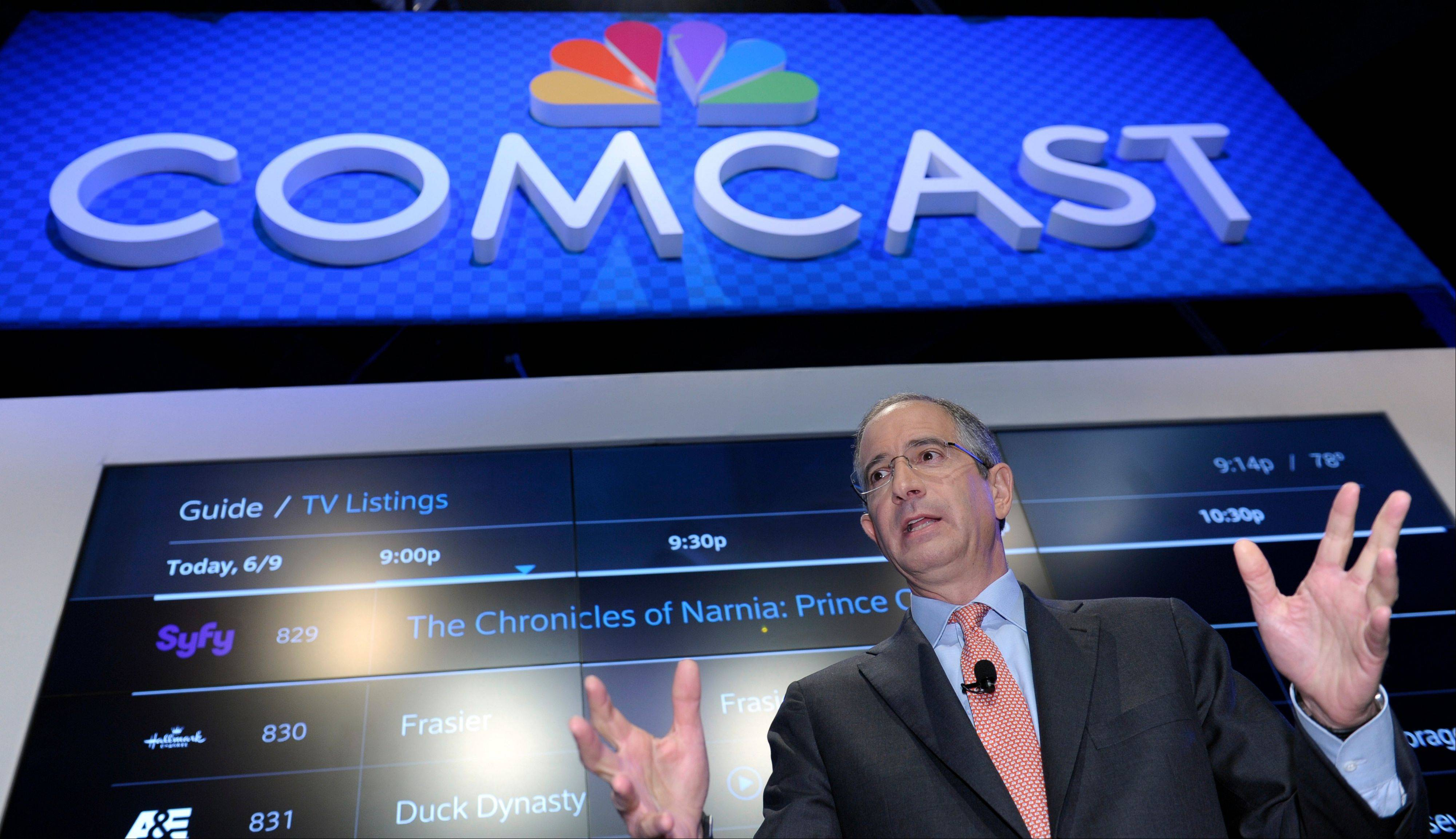 Comcast Corp. CEO Brian Roberts gestures as he speaks during The Cable Show 2013 convention in Washington, Tuesday, June 11, 2013. TV was supposed to everywhere by now _on your smartphone, on your tablet. Your favorite shows were supposed to be watchable anytime, anywhere.