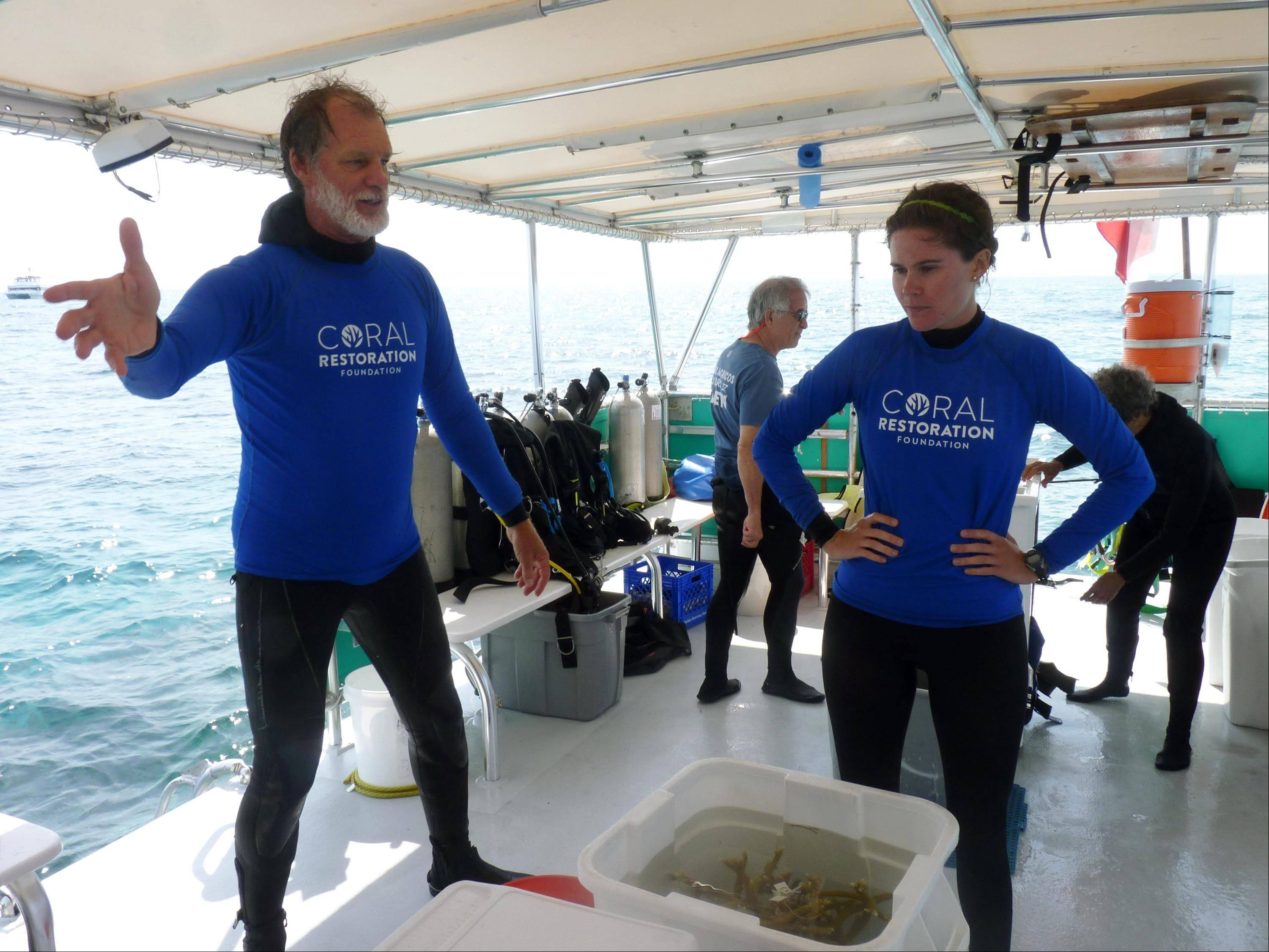 Ken Nedimyer, left, and Kayla Ripple during a workshop on restoring coral reefs in Key Largo, Fla. Nedimyer has been breathing new life into coral reefs for more than a decade with his Coral Restoration Foundation.