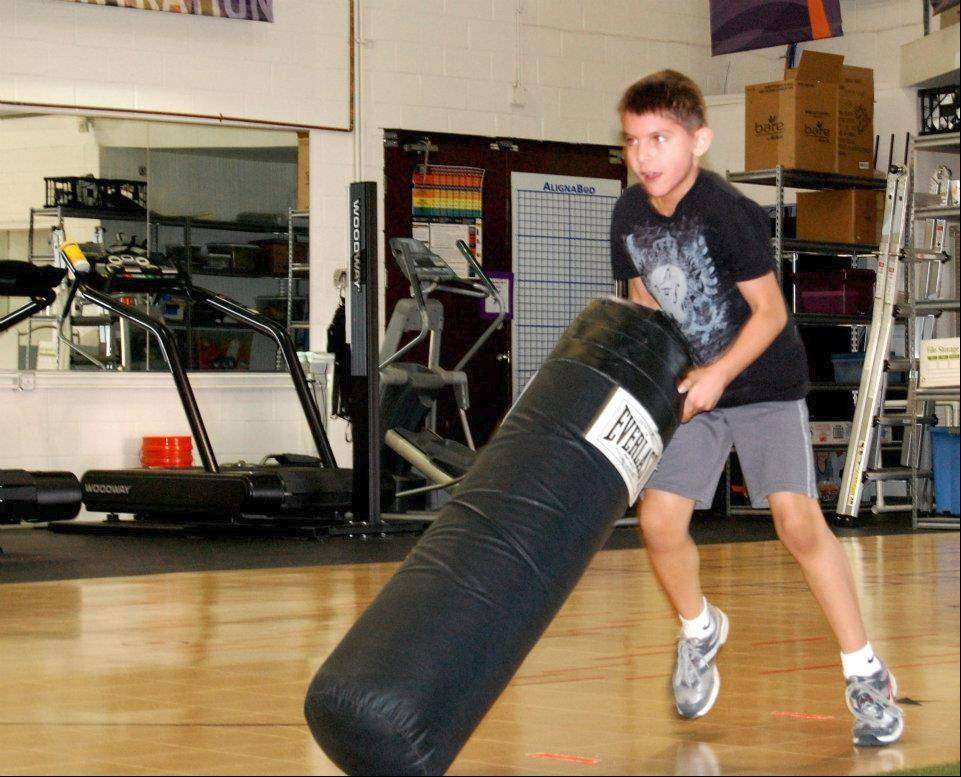 Eddie Resendez, 9, pushes a sled with weights at Academy for Athletic Advancement, which works with children as young as 8 for both weight control and conditioning for sports.