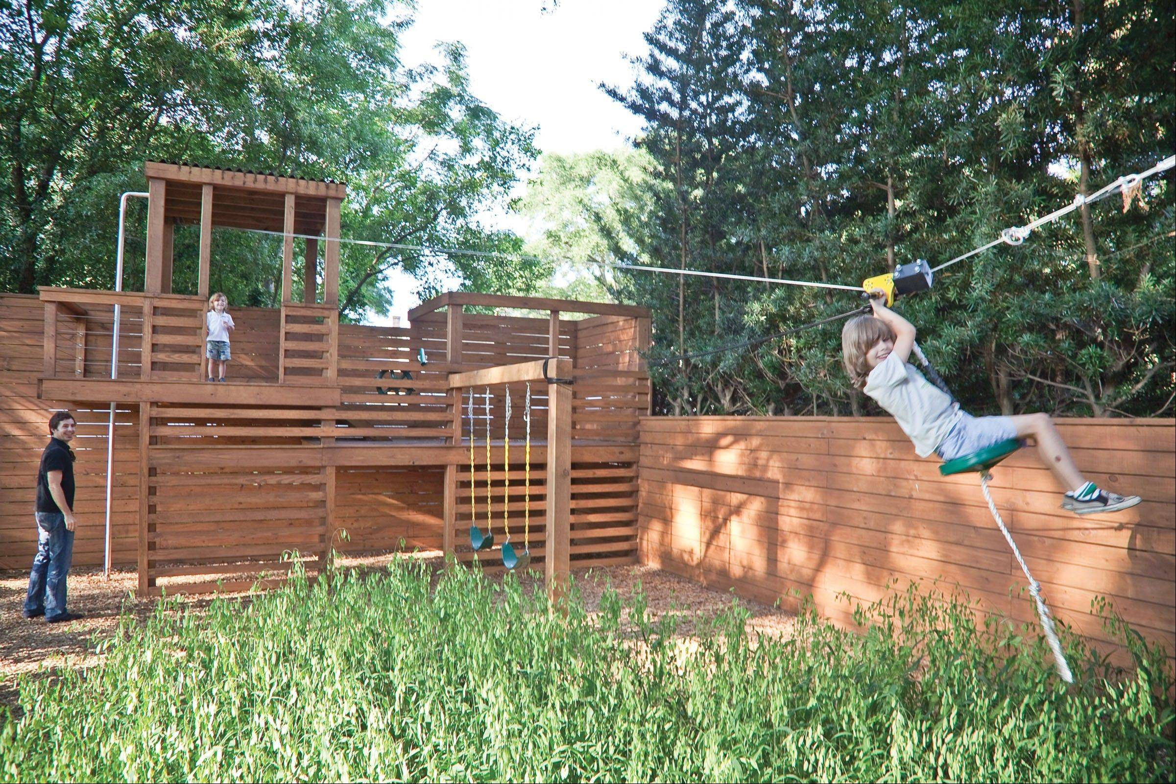 The Kramers' treehouse-like jungle gym blends into the backyard's fence and complements the natural surroundings, creating a playful area that adults can enjoy, too.