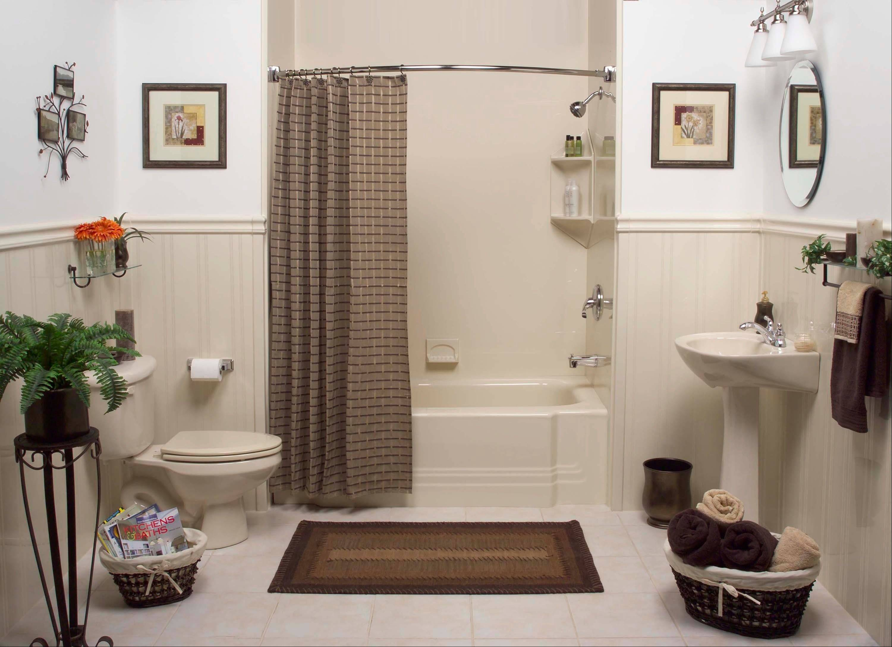 A liner that slips over the existing tub, as well as wall panels, create a near-instant update of an aging bathroom.