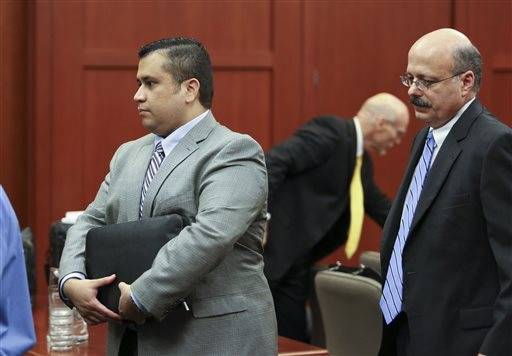 George Zimmerman, left, leaves the court room ahead of Assistant State Attorney Bernie de la Rionda at the conclusion of the fifth day of jury selection during his trial in Seminole circuit court in Sanford, Fla., Friday June 14, 2013. Zimmerman has been charged with second-degree murder for the 2012 shooting death of Trayvon Martin.
