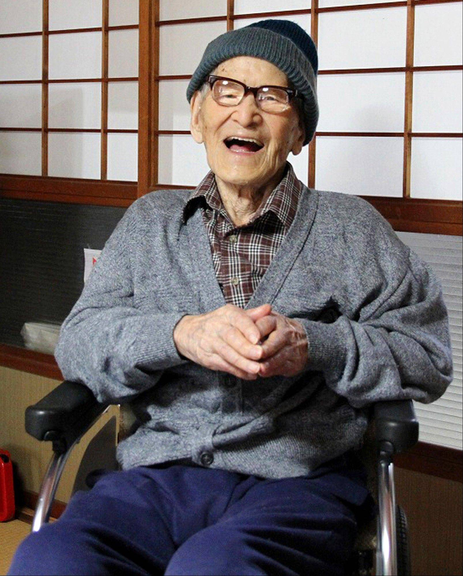 Jiroemon Kimura smiles after he was presented with the certificate of the world's oldest living man from Guinness World Records.