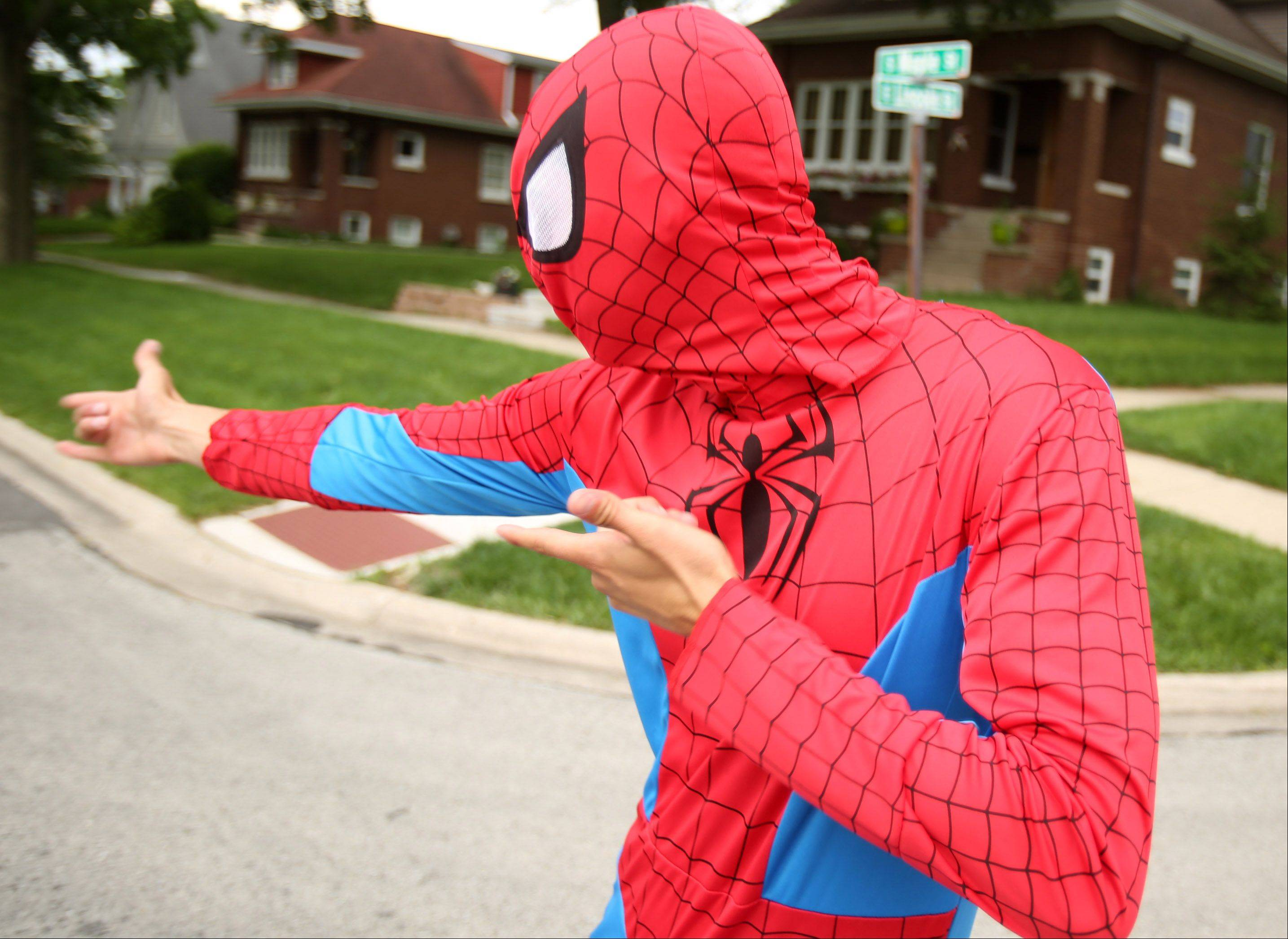 Pete Nocchi, a lifeguard with the Mount Prospect Park District, directs runners Saturday in the park district's Super 5K Run at Lions Memorial Park in Mount Prospect. Participants were encouraged to dress in their favorite superhero costumes.