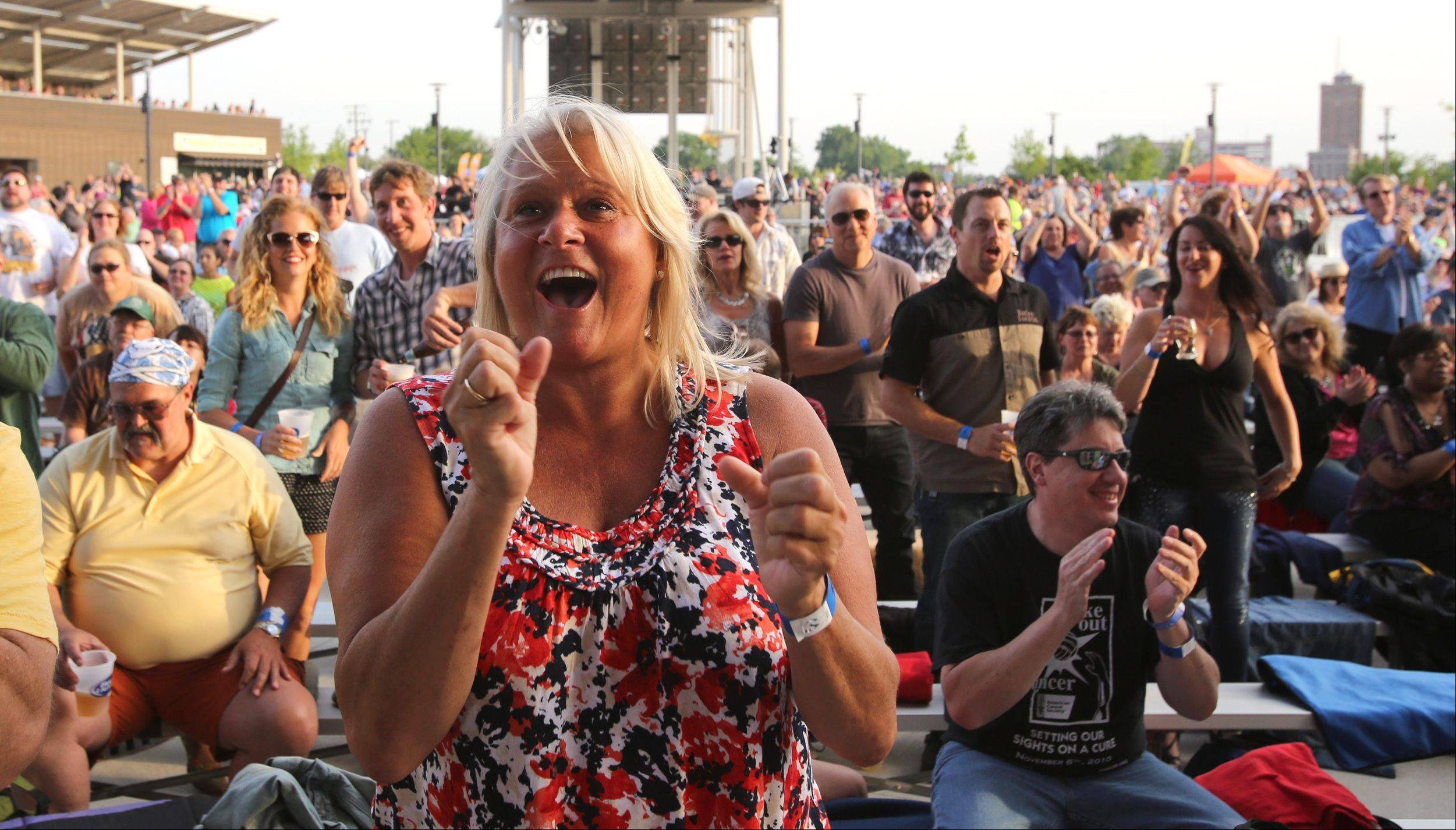 Nicki Rozmarnowski cheers on opening act JJ Grey & Mofro on Friday during the opening night as RiverEdge Park hosted its opening night and Blues on the Fox.
