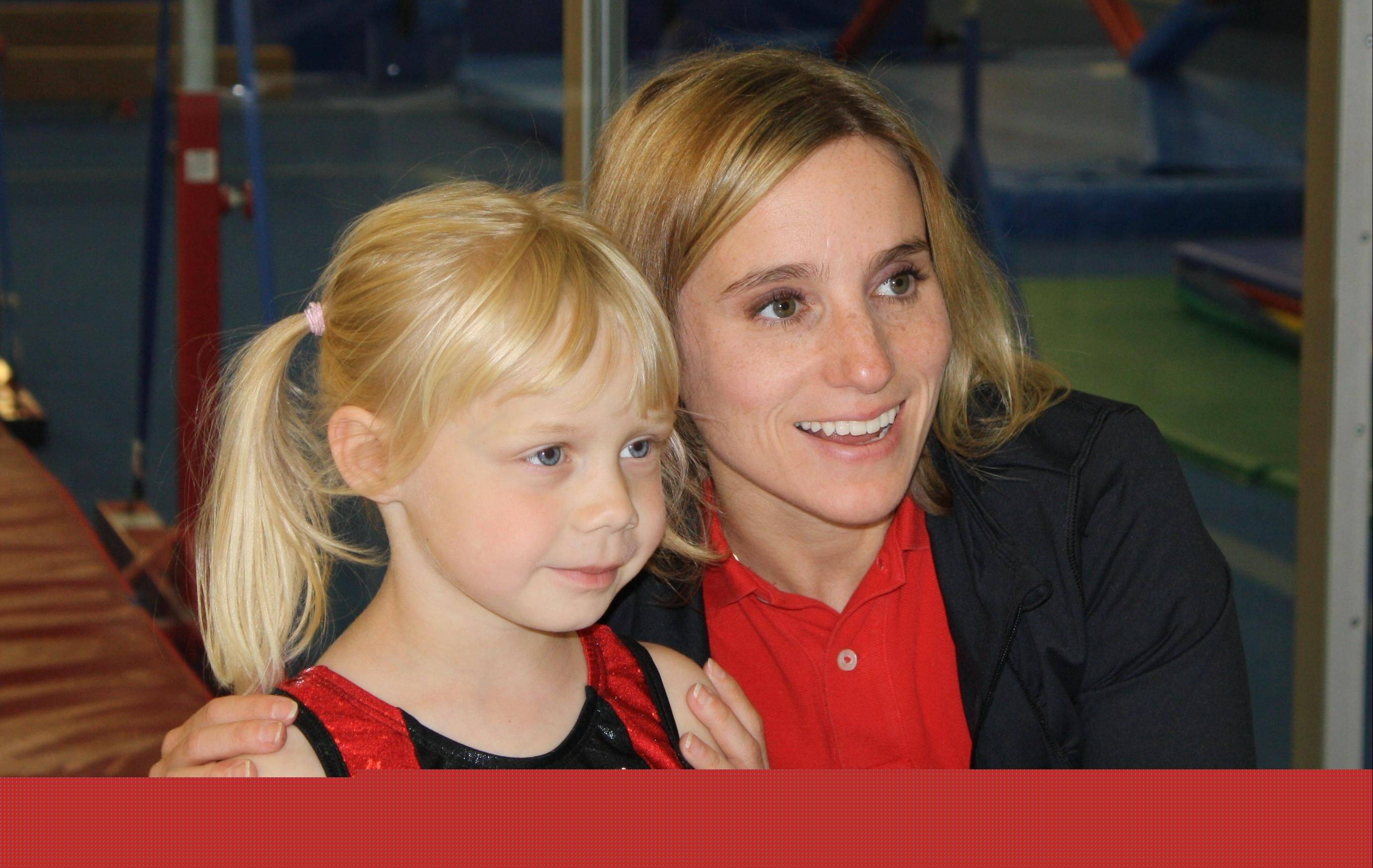 Young Gracie Donnelly, a gymnast at Midwest Elite Gymnastics Academy in Elgin, got to meet U.S. Olympic gold medalist gymnast Kerri Strug on Friday. Strug was promoting the final qualifying event for the U.S. Gymnastics Championships.