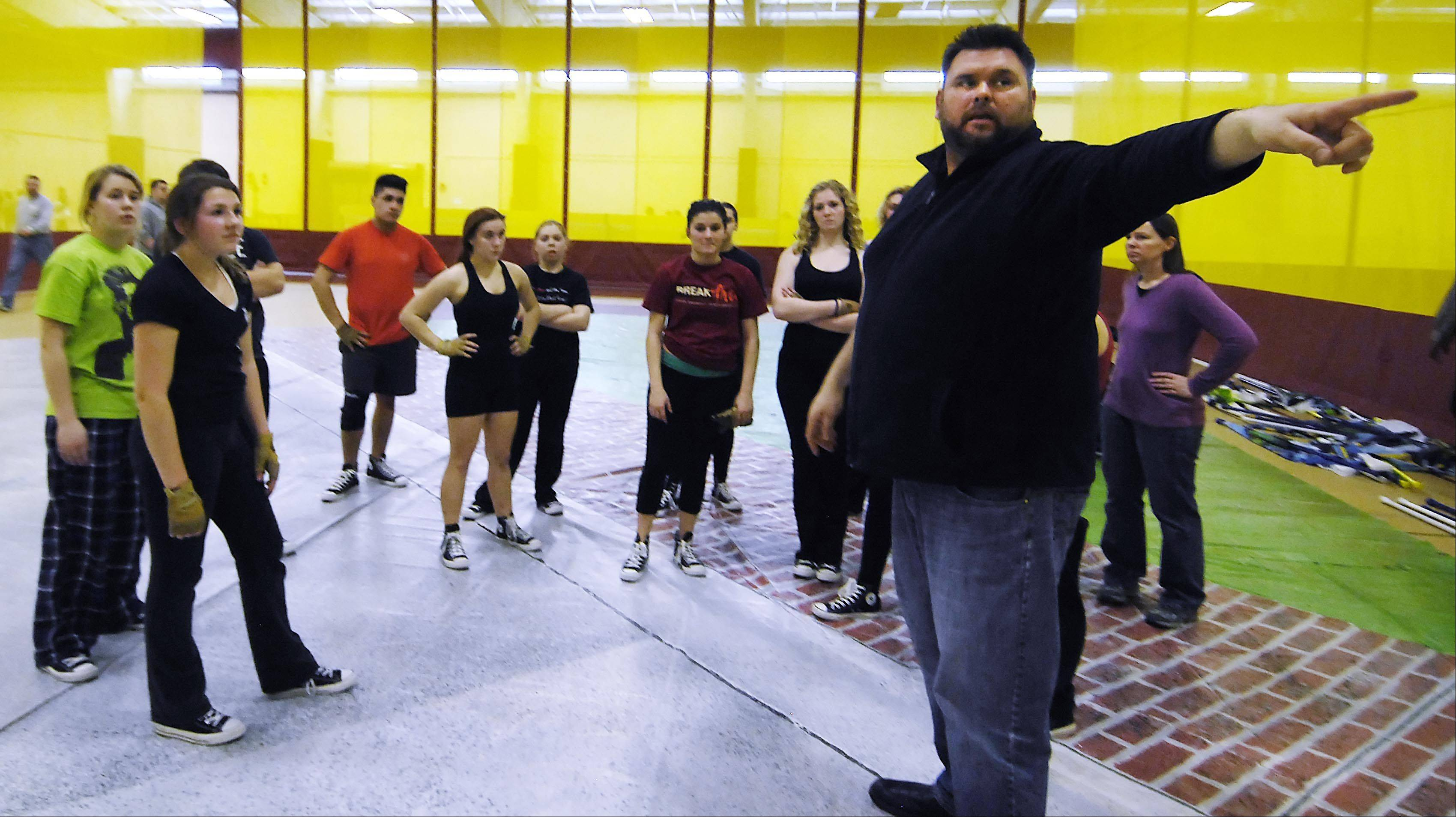 Eric Hall, director of the Allegiance Youth Color Guard of Dundee, tells his A team, made up of youths ages 14 to 22, where to go to enter the competition gymnasium at Batavia High School earlier this year.