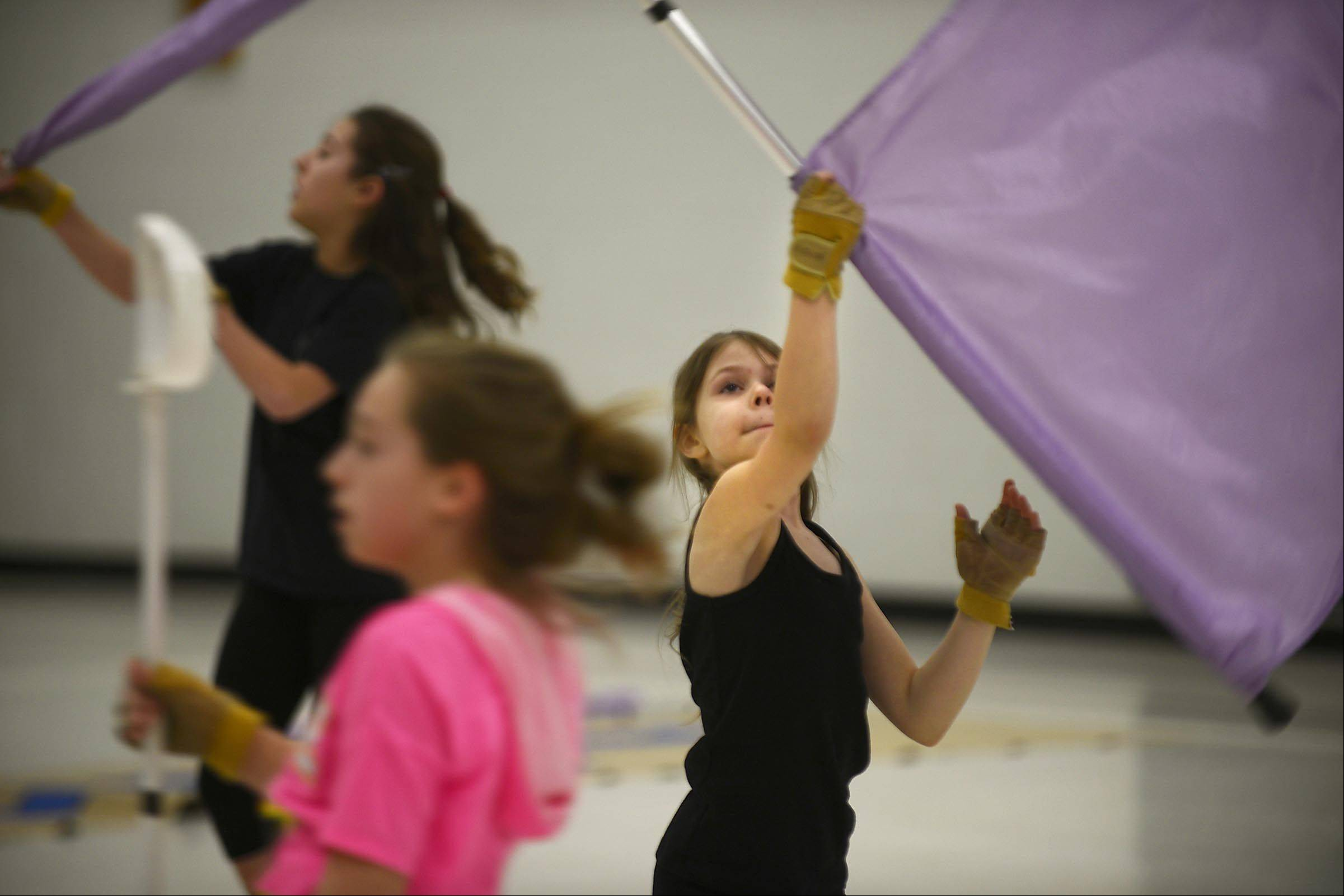 The Allegiance Youth Color Guard Cadets, made up of kids ages 6 to 13, practice their 3-minute routine at Sunny Hill School in Carpentersville.