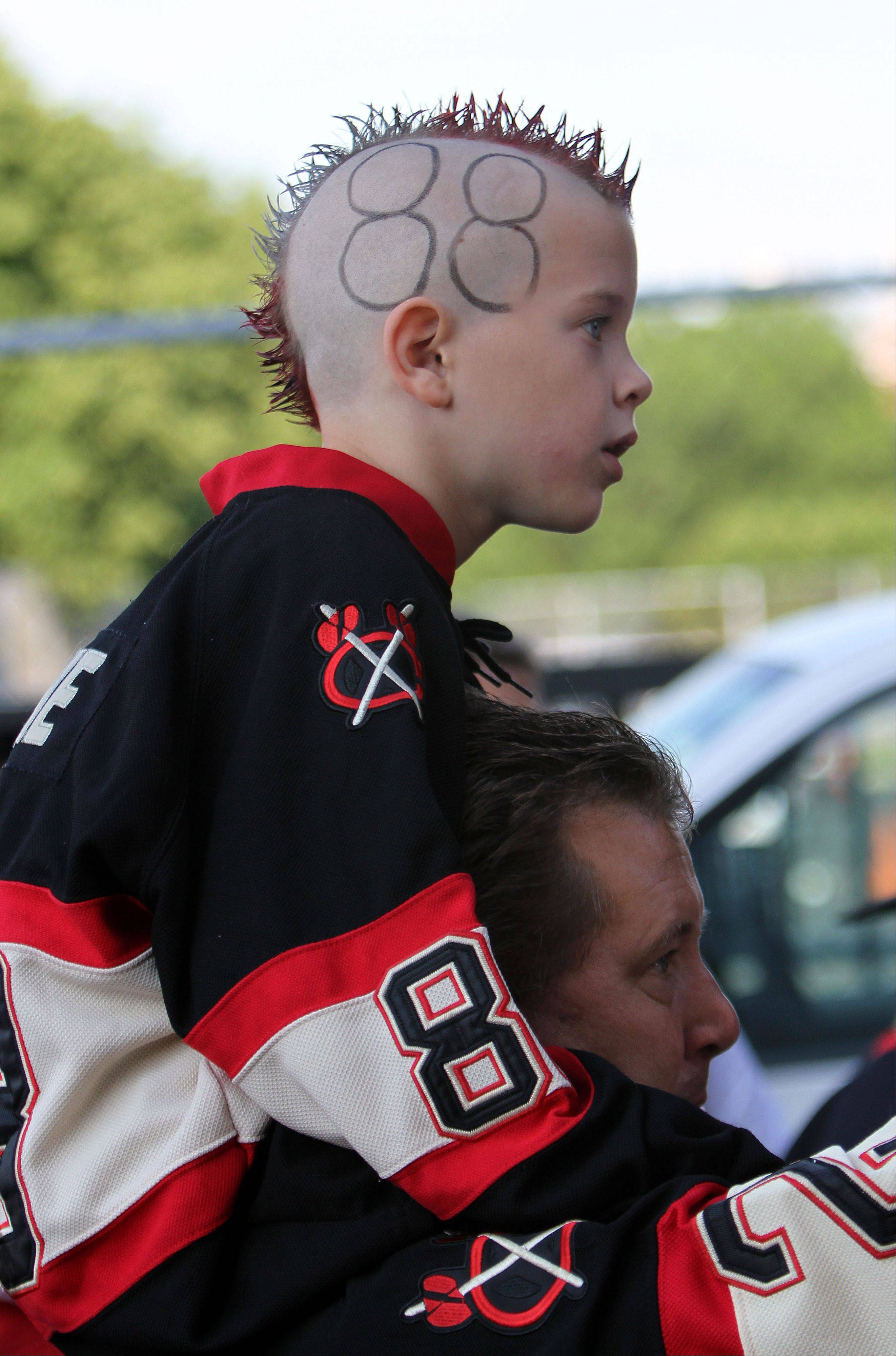 Trent Steffel, 7, of Frankfort sports a cool hairstyle -- and Patrick Kane's No. 88 -- Saturday as he sits on his father Bob's shoulders outside the United Center.