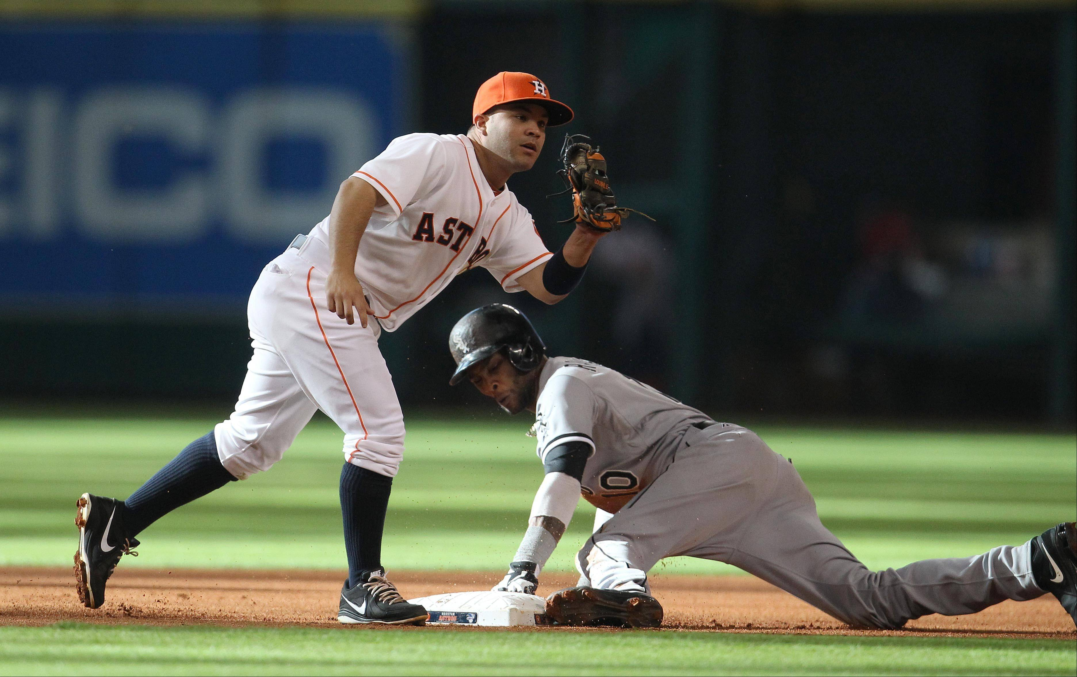 Houston Astros second baseman Jose Altuve tries to get the tag on Chicago White Sox's Alexei Ramirez (10) as he steals second base during the first inning of a baseball game, Saturday, June 15, 2013, in Houston.
