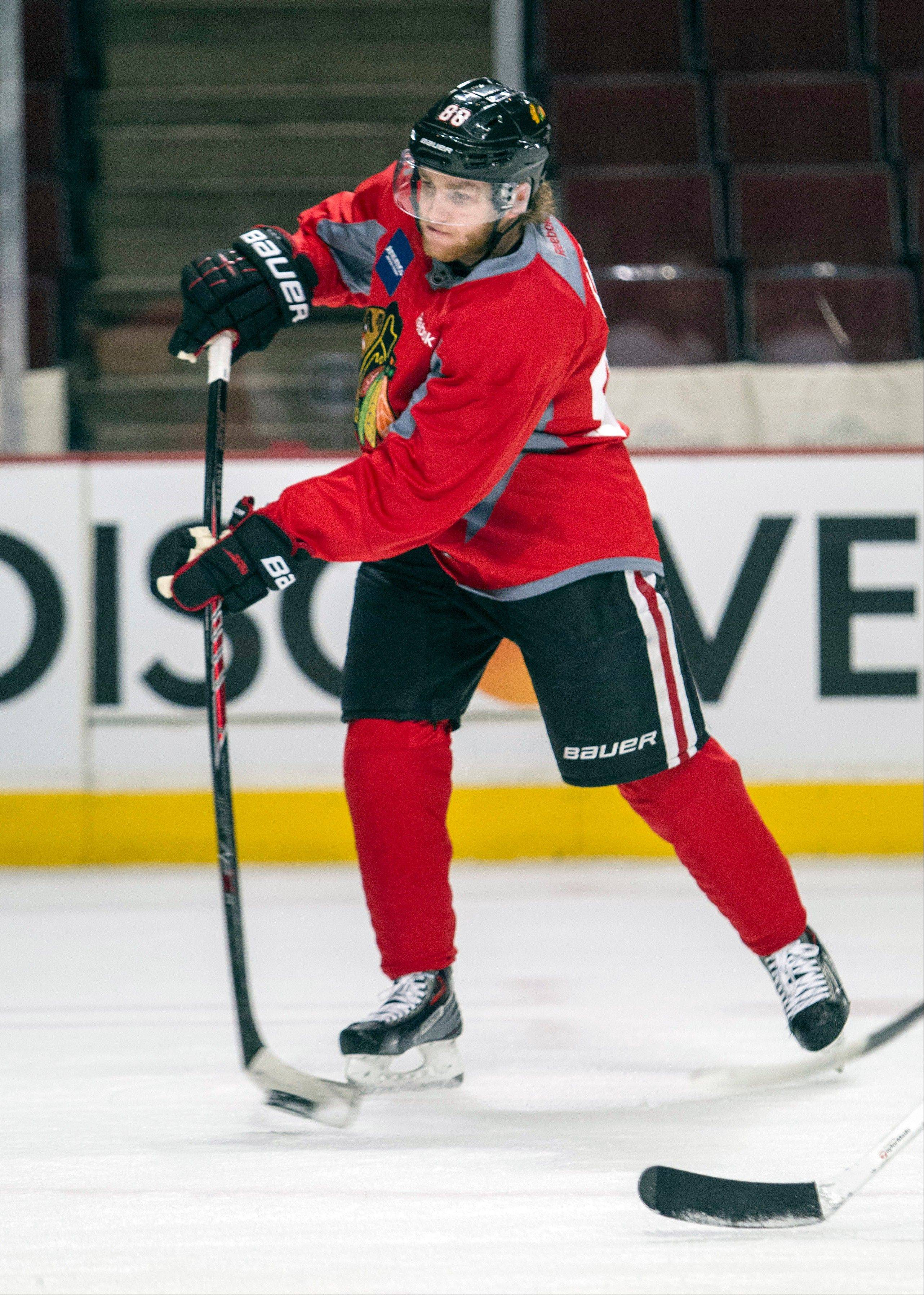 Blackhawks right wing Patrick Kane fires off a shot during Friday's practice.