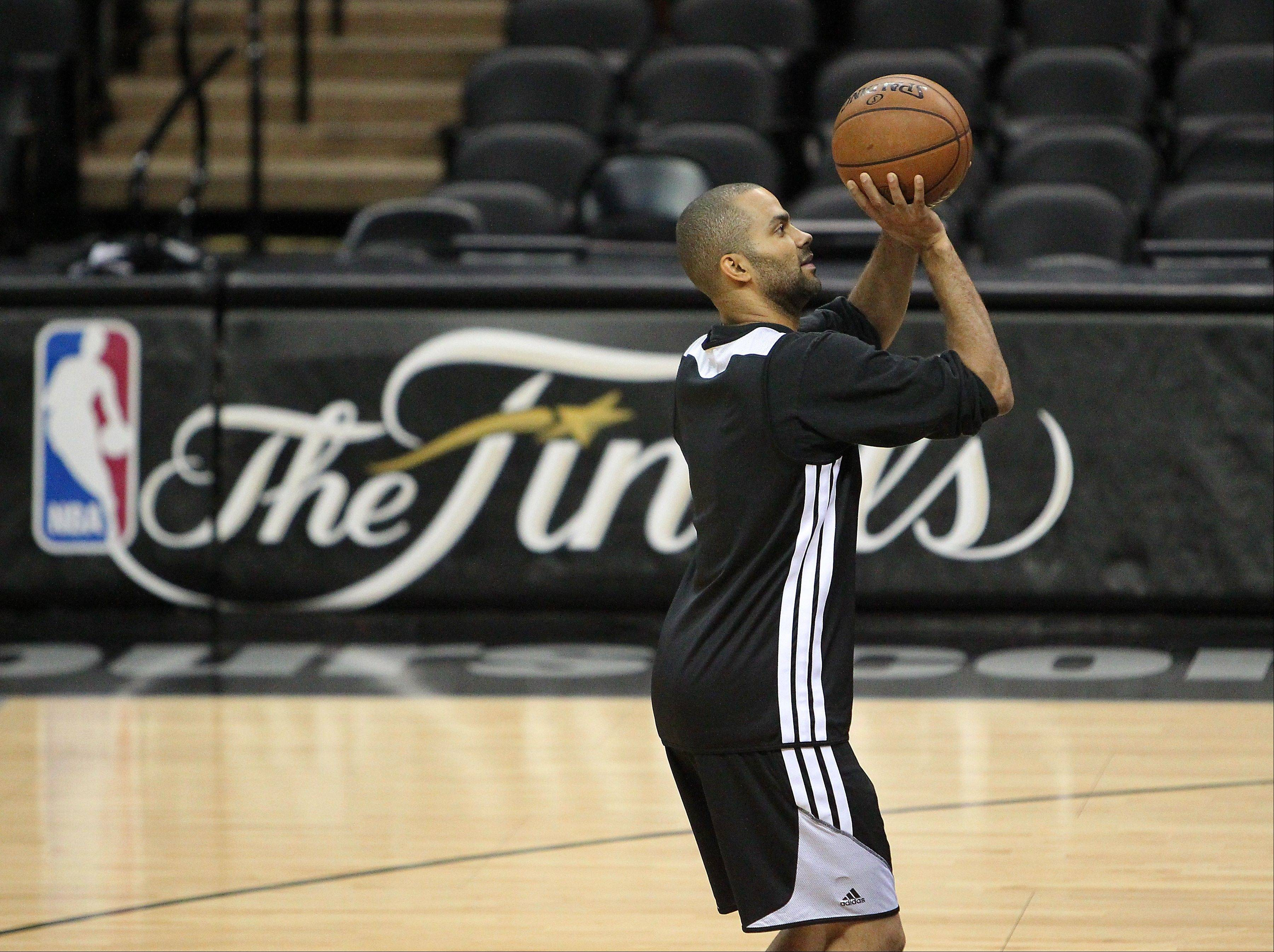 San Antonio Spurs guard Tony Parker shoots during NBA basketball practice, Saturday, June 15, 2013, in San Antonio. The Spurs host the Miami Heat in Game 5 of the NBA Finals on Sunday, with the best-of-seven games series even at 2-2. (AP Photo/El Nuevo Herald, David Santiago) MAGS OUT