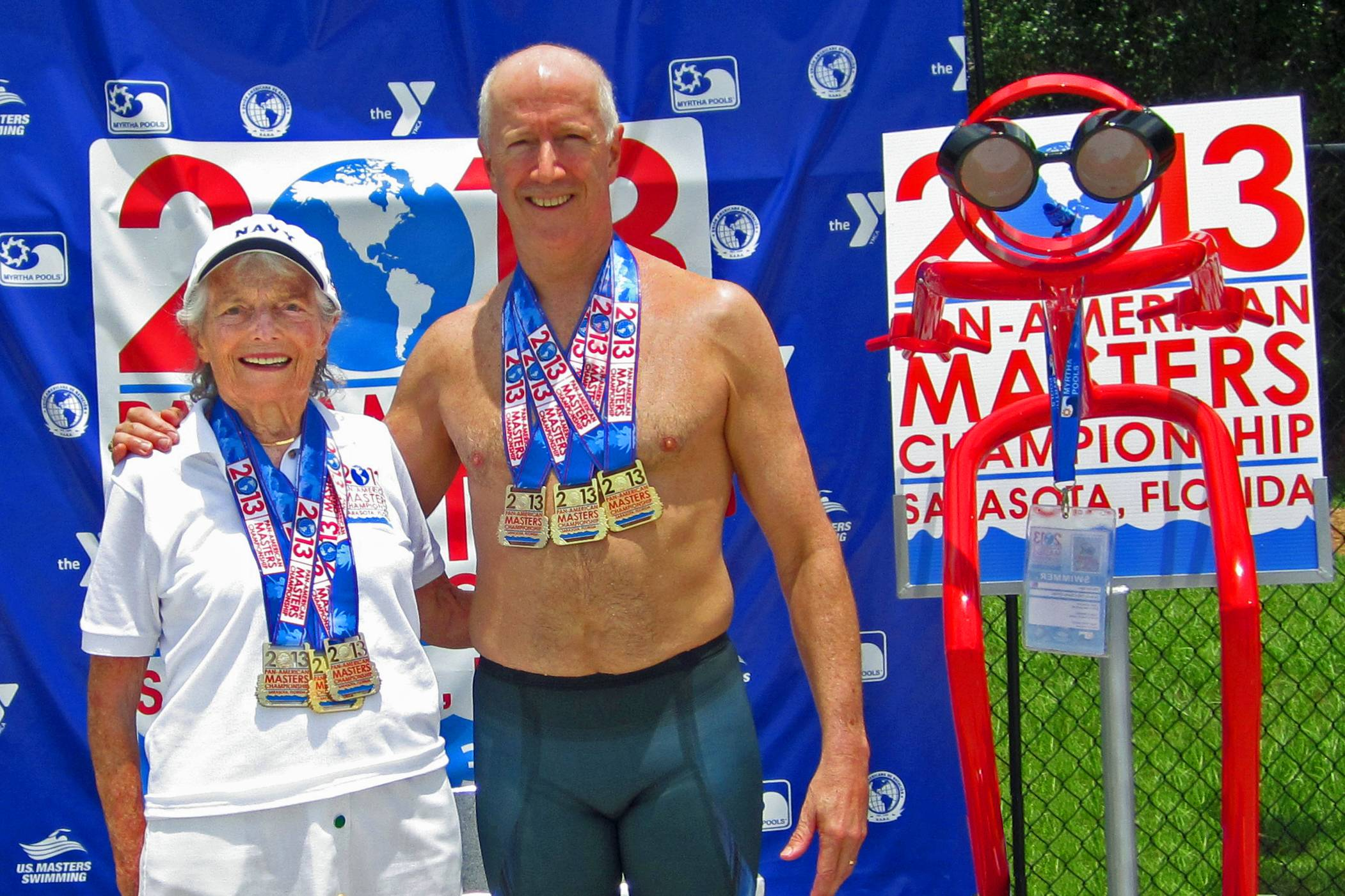 Nancy and Phil Dodson, mother and son show off their three Pan Am gold medals in Sarasota FL  6/11/13