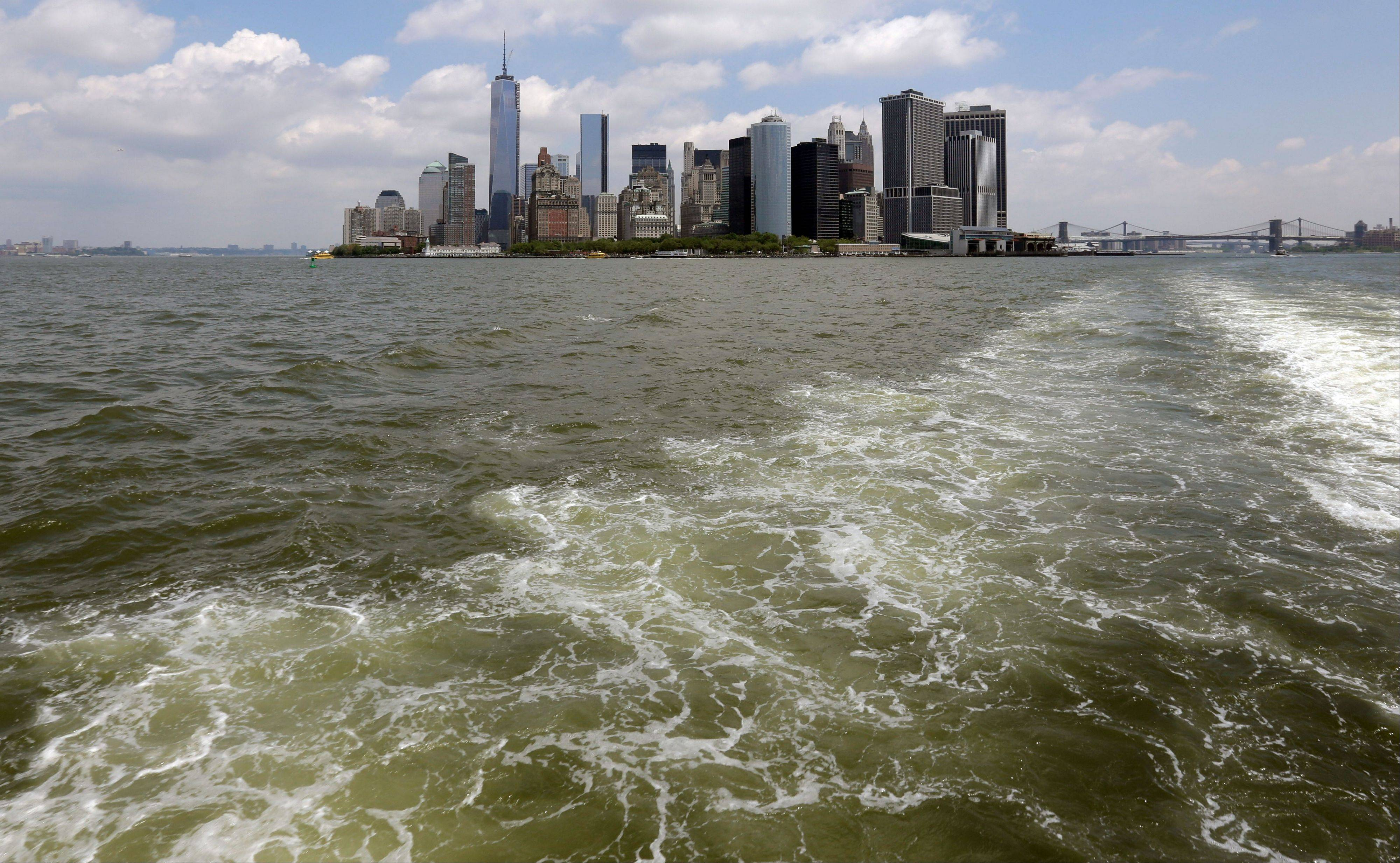 Lower Manhattan is visible from the Staten Island Ferry, in New York�s Upper Bay. Giant removable floodwalls would be erected around lower Manhattan, and levees, gates and other defenses could be built elsewhere around the city under a nearly $20 billion plan proposed Tuesday by Mayor Michael Bloomberg.