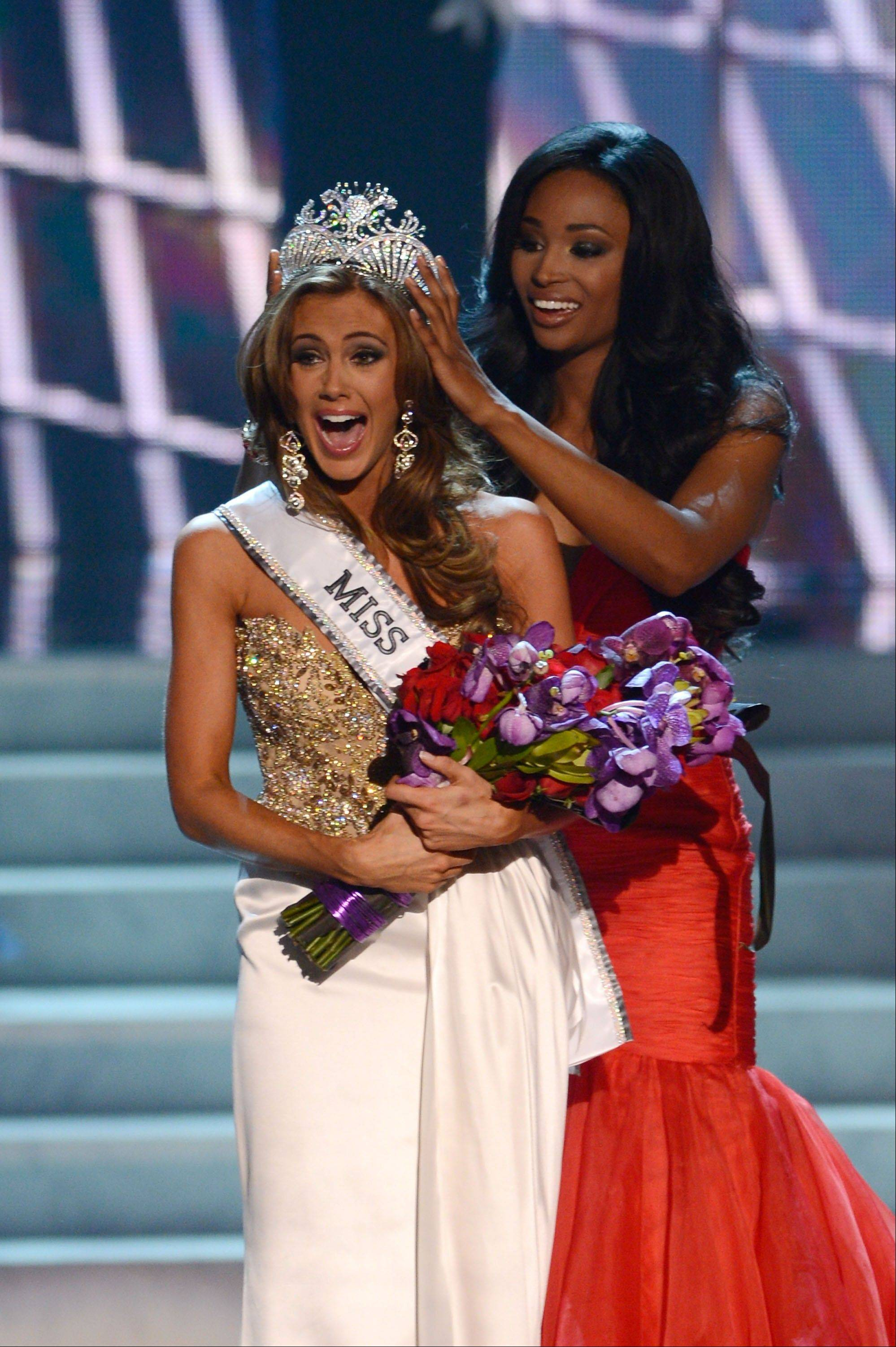 Miss Connecticut Erin Brady is crowned the winner of the Miss USA 2013 pageant by Nana Meriwether, Sunday, June 16, 2013, in Las Vegas.