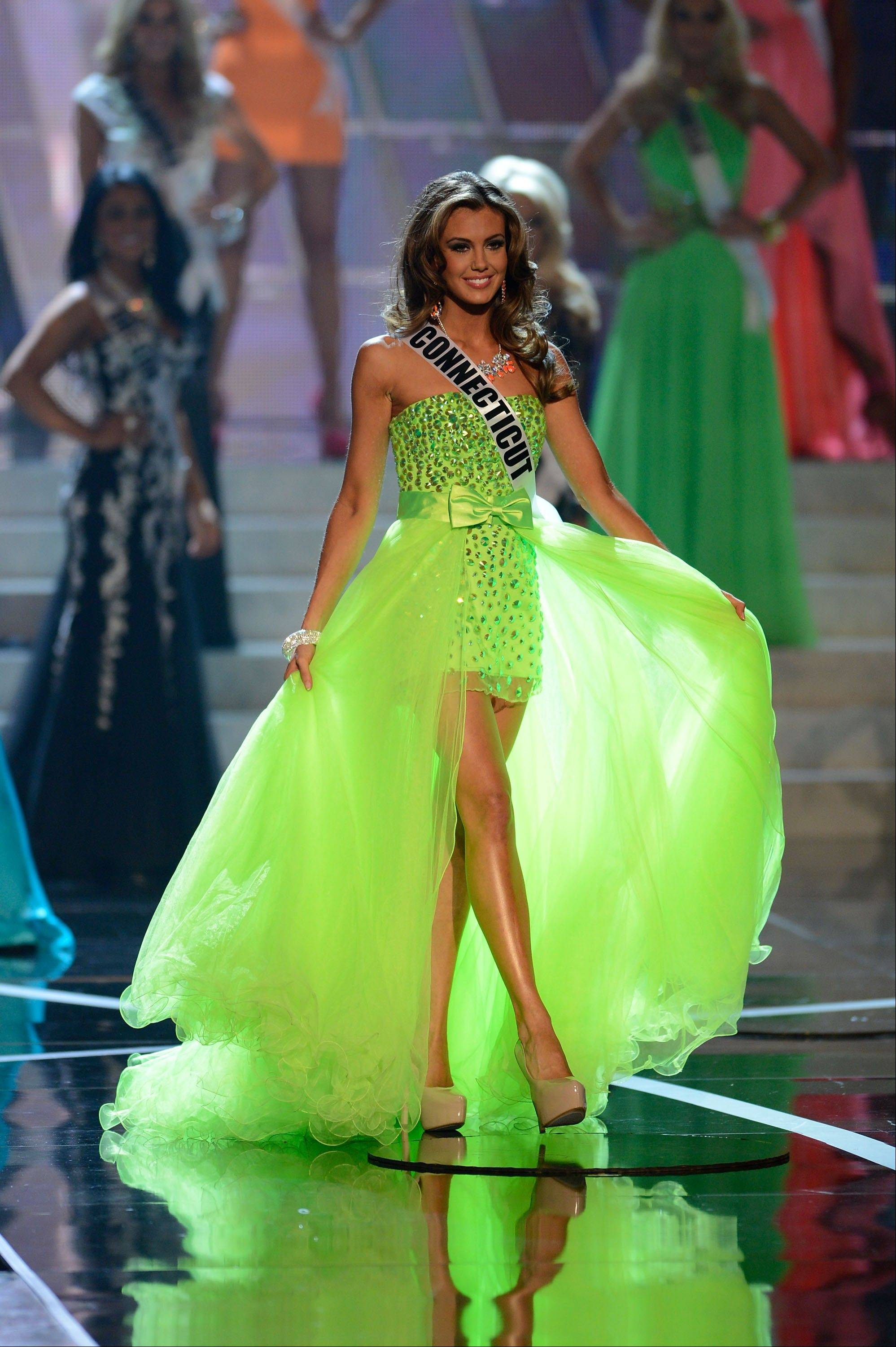 Miss Connecticut Erin Brady, from Glastonbury, Conn., walks the runway during the introductions of the Miss USA 2013 pageant, Sunday, June 16, 2013, in Las Vegas.