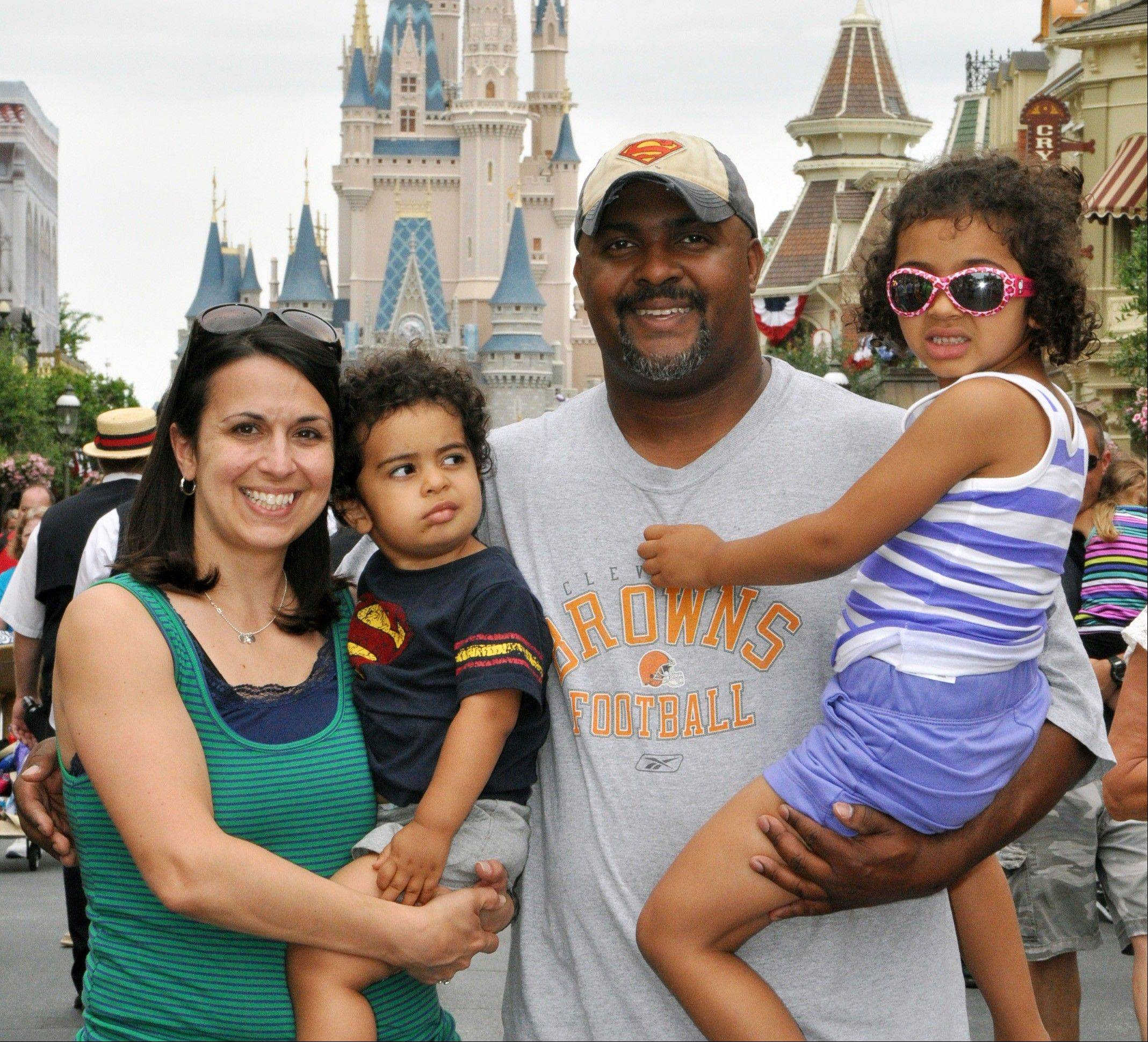 "Creed Anthony of Indianapolis spends time with his daughter Sophie, 5, son Isaac, 2, and wife Amal, on a visit to Disney World's Magic Kingdom in Lake Buena Vista, Fla. Anthony is an example of a new generation of hands-on dads who don't just change the occasional diaper but who view ""parenting as a partnership,"" as he put it."