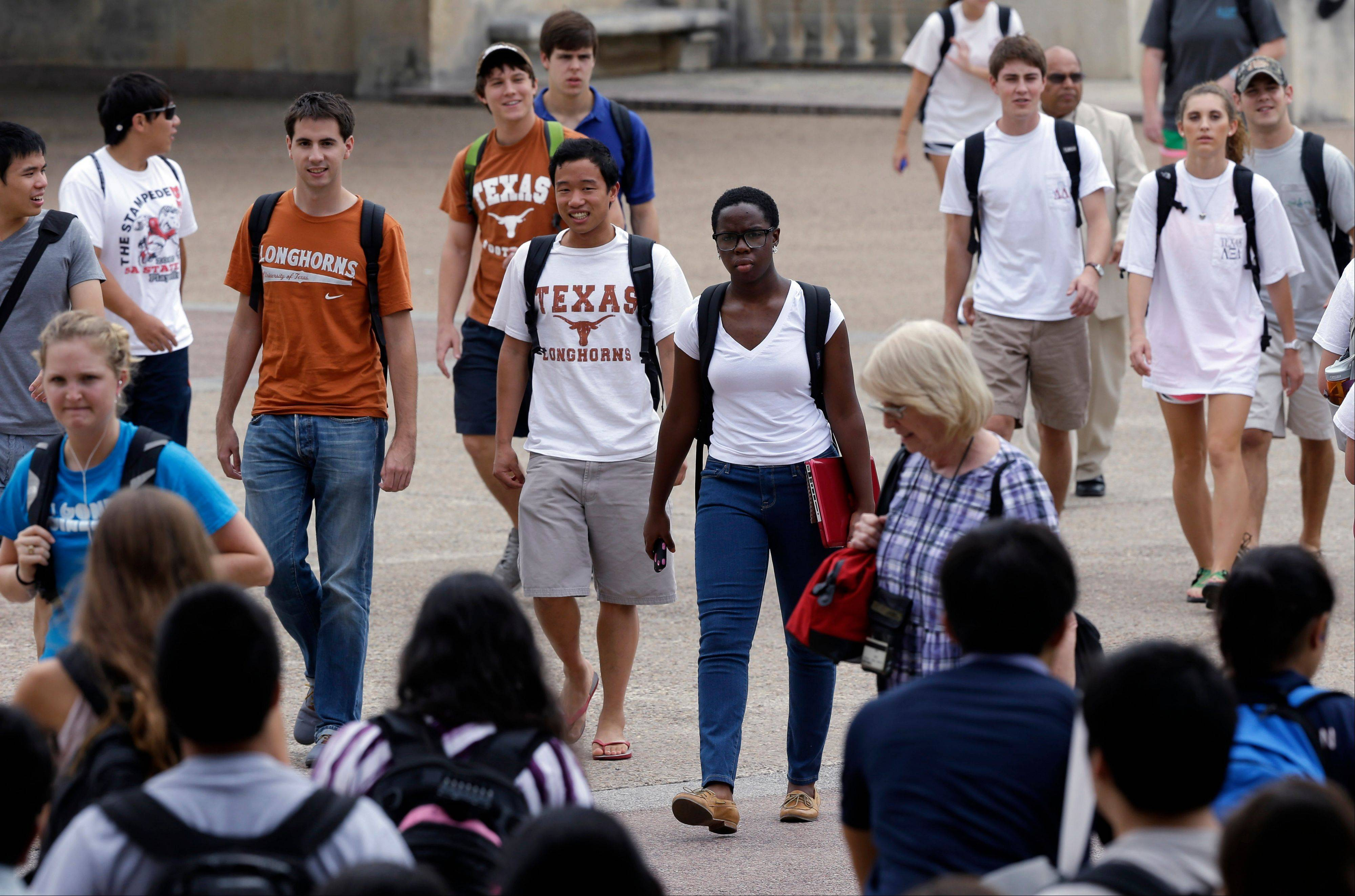 Students walk through the University of Texas at Austin campus in Austin, Texas. This giant flagship campus — once slow to integrate — is now among the most diverse the country.