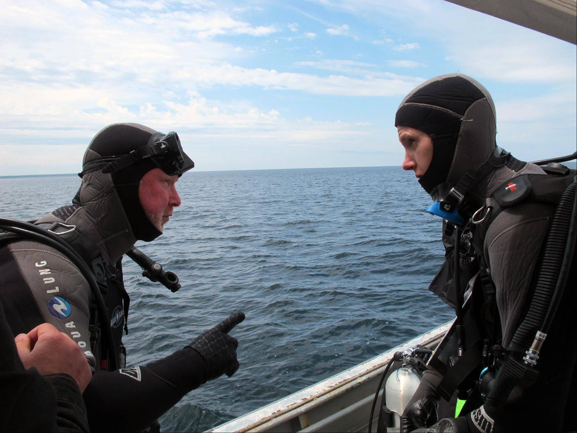 Michel LíHour, left, director of Franceís Department of Underwater Archaeological Research, talks with colleague Olivia Hulot before diving to the site of what may be the fabled Griffin shipwreck Saturday in northern Lake Michigan.