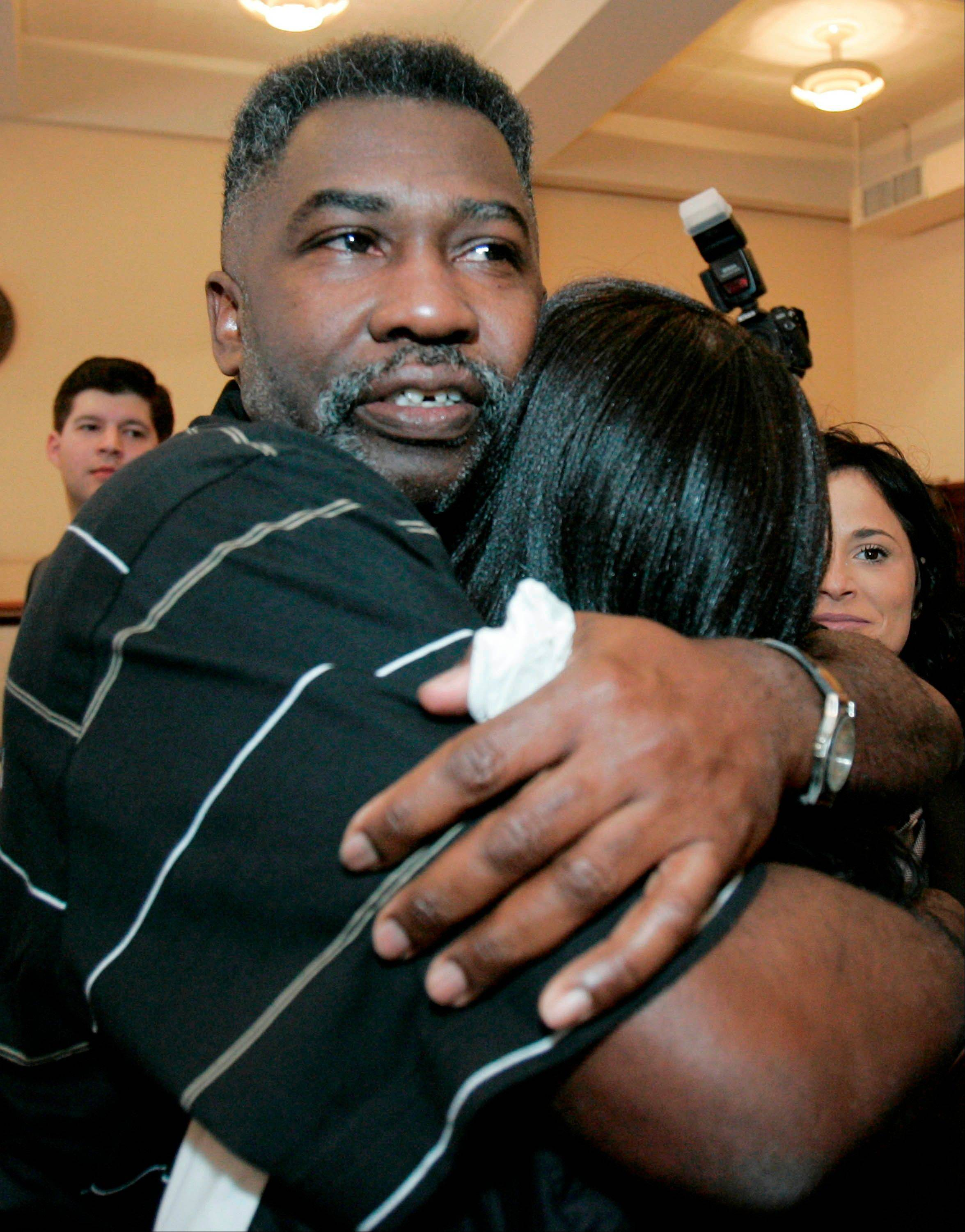 Levon Brooks, left, hugs a friend moments after a judge released him in 2008 pending a new trial for the murder of a child in Macon, Miss. Brooks was convicted in 1992 of raping and killing his ex-girlfriend's 3-year-old daughter and sentenced to life in prison. He was exonerated after years of fighting by the Mississippi Innocence Project.