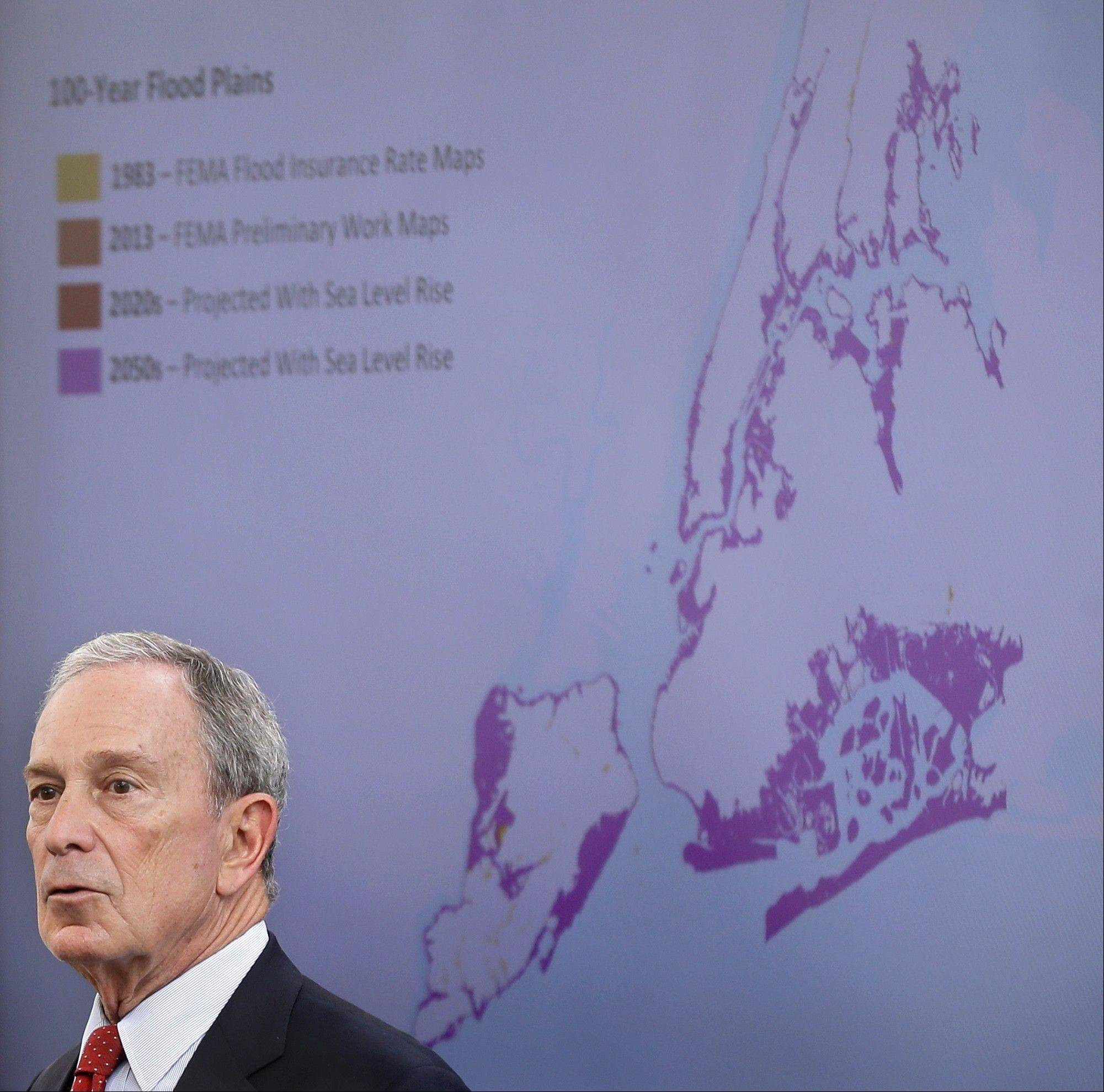 New York City Mayor Michael Bloomberg speaks Tuesday while a map of the projected 2050s 100-year flood plain of New York City is displayed in New York.