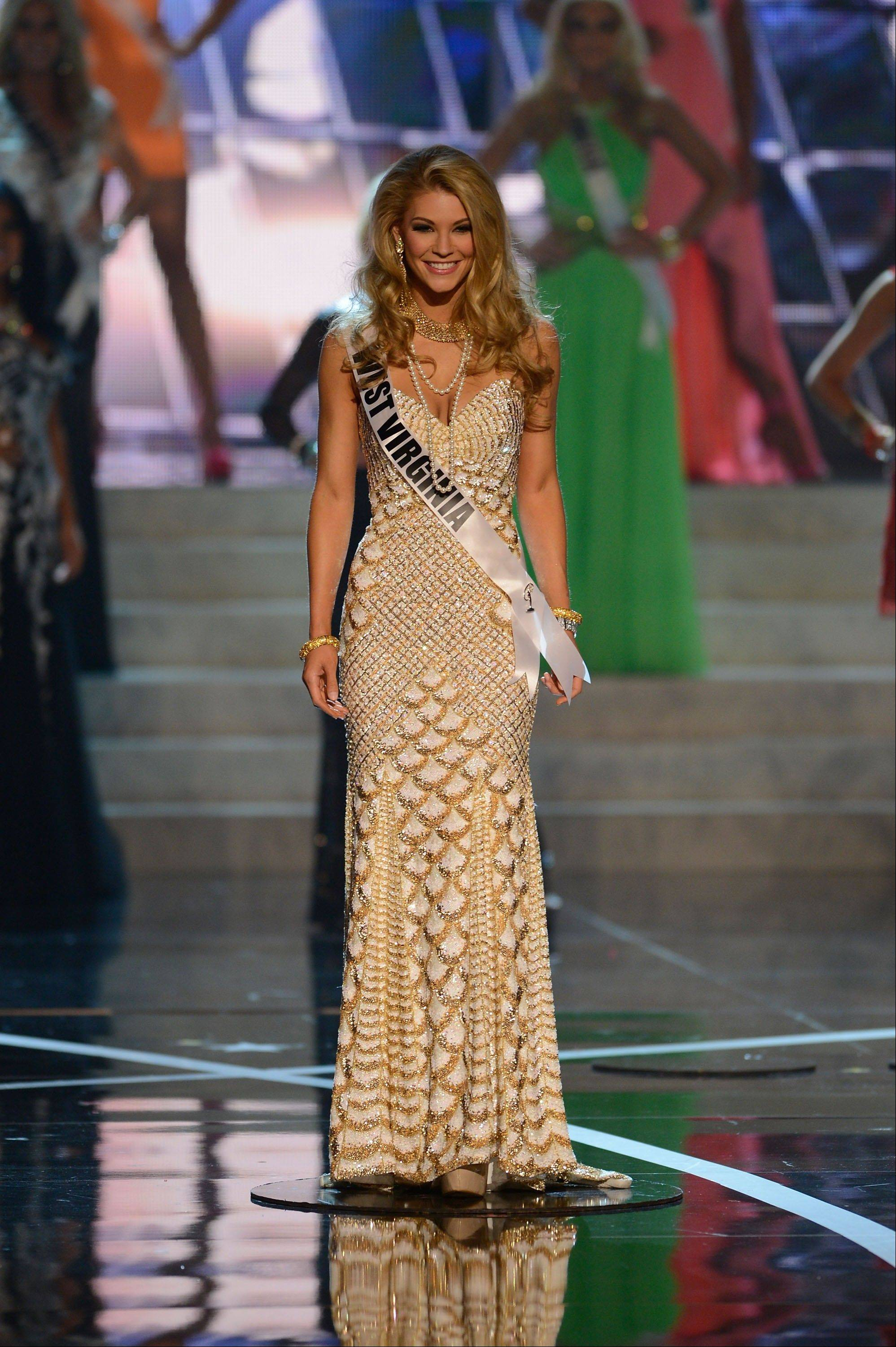Miss West Virginia Chelsea Welch walks the runway during the introductions of the Miss USA 2013 pageant, Sunday, June 16, 2013, in Las Vegas.