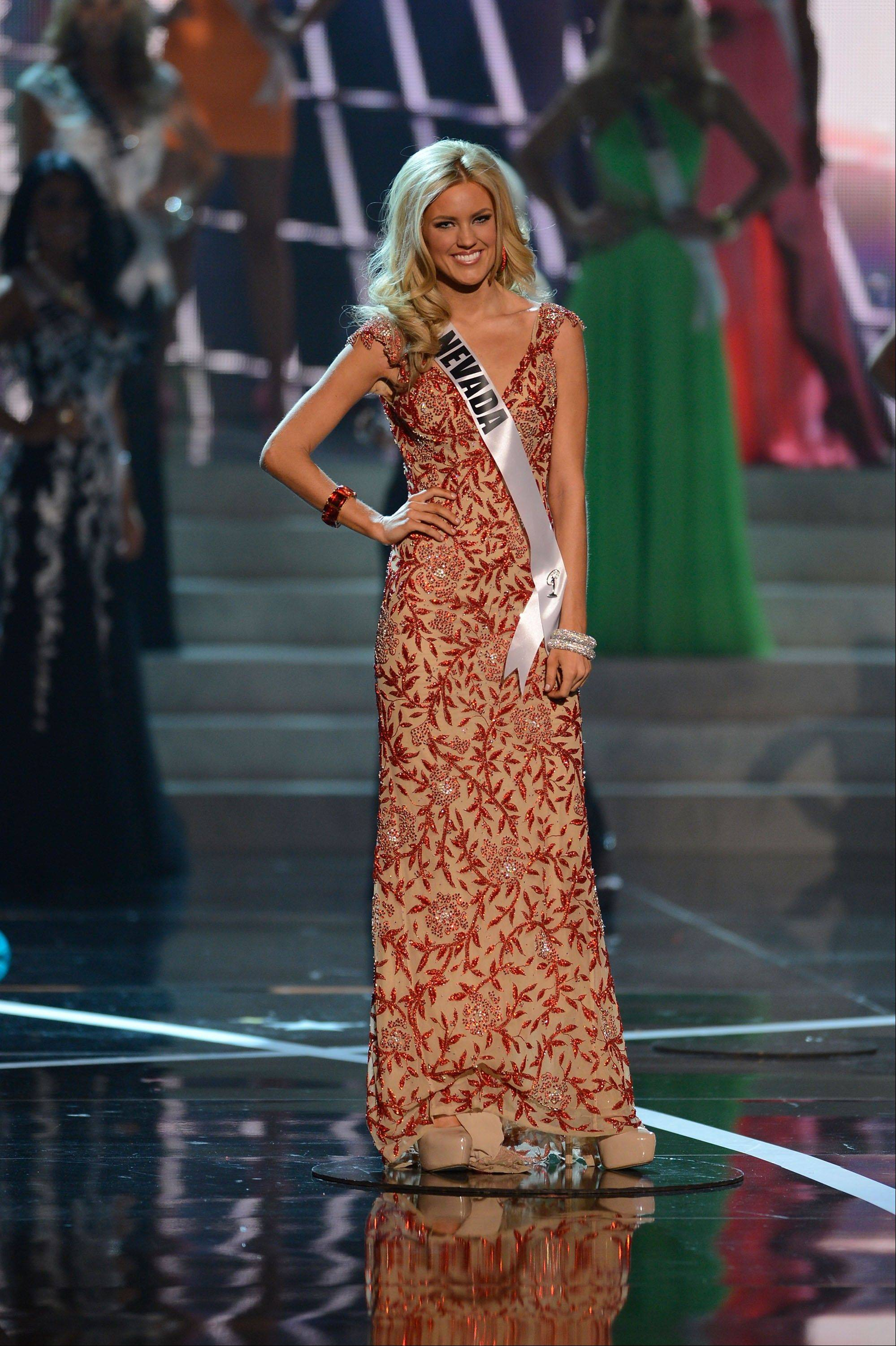 Miss Nevada Chelsea Caswell, from Las Vegas, Nev., walks the runway during the introductions of the Miss USA 2013 pageant, Sunday, June 16, 2013, in Las Vegas.