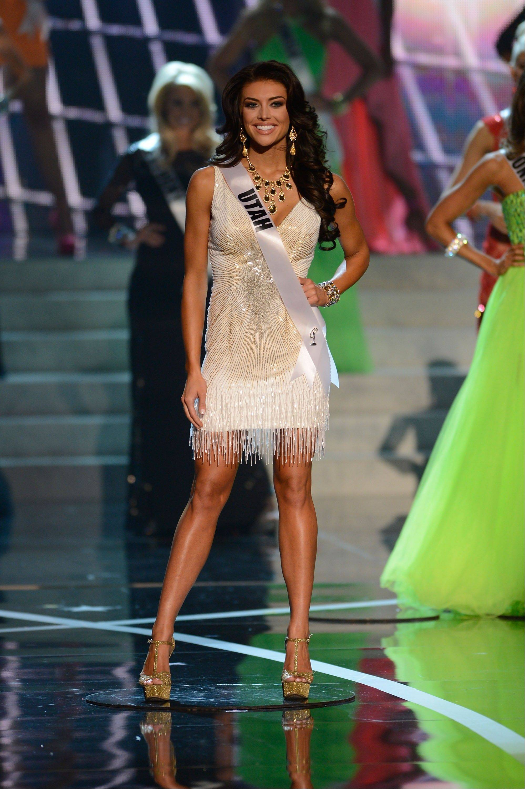Miss Utah Marissa Powell walks the runway during the introductions of the Miss USA 2013 pageant, Sunday, June 16, 2013, in Las Vegas.