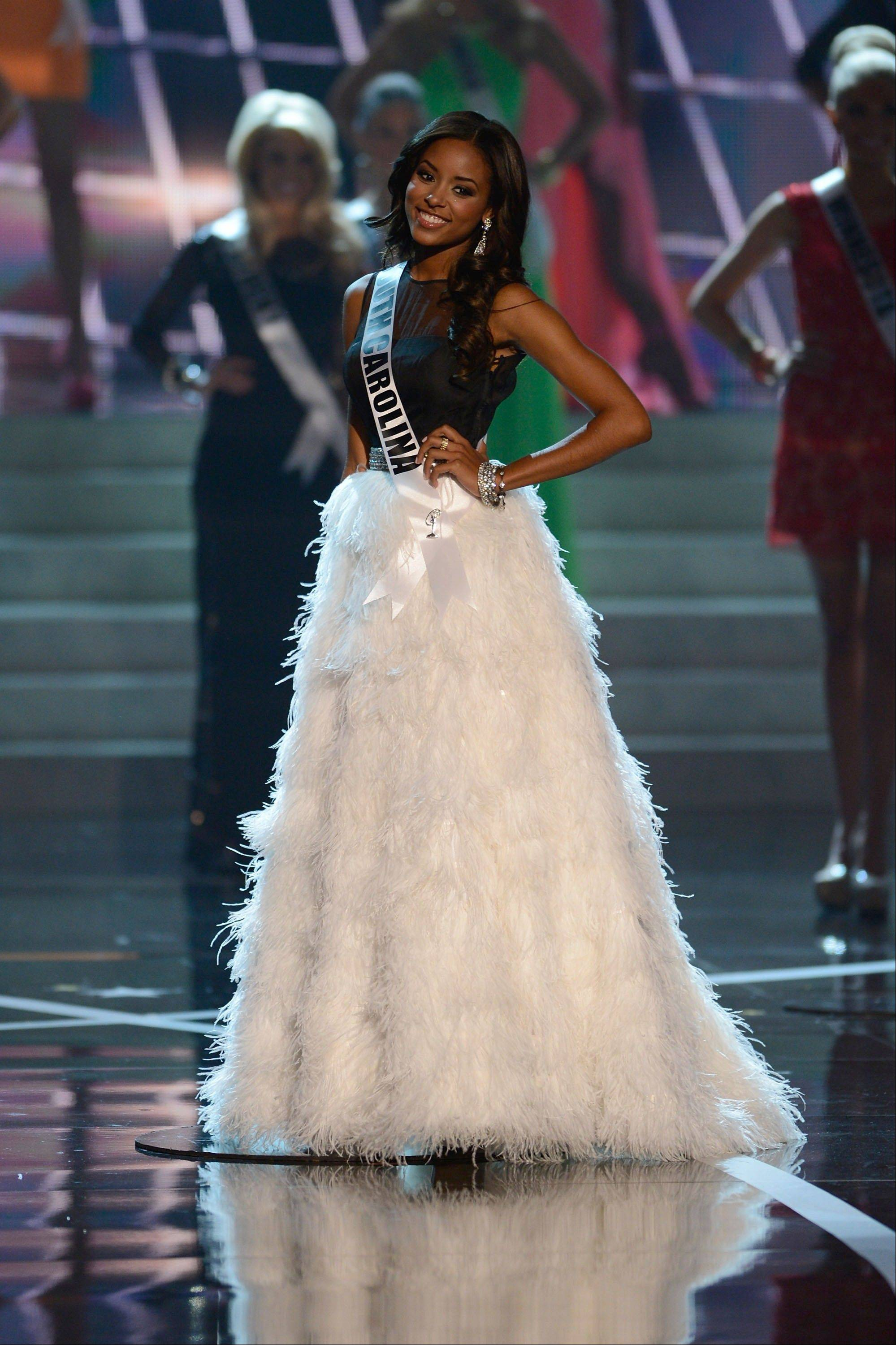 Miss South Carolina Megan Pickney walks the runway during the introductions of the Miss USA 2013 pageant, Sunday, June 16, 2013, in Las Vegas.