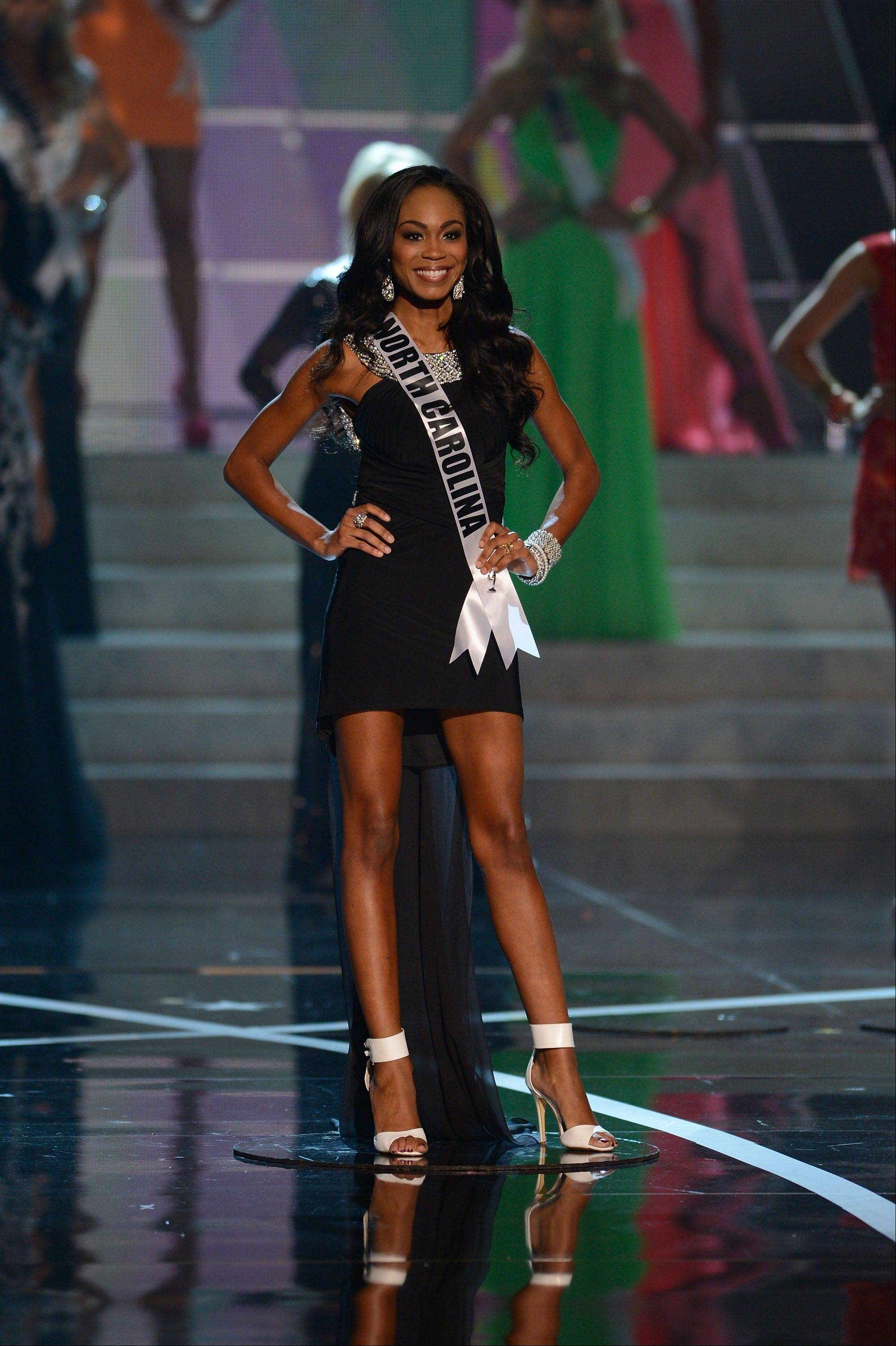 Miss North Carolina Ashley Mills, from Raleigh, N.C,, walks the runway during the introductions of the Miss USA 2013 pageant, Sunday, June 16, 2013, in Las Vegas.