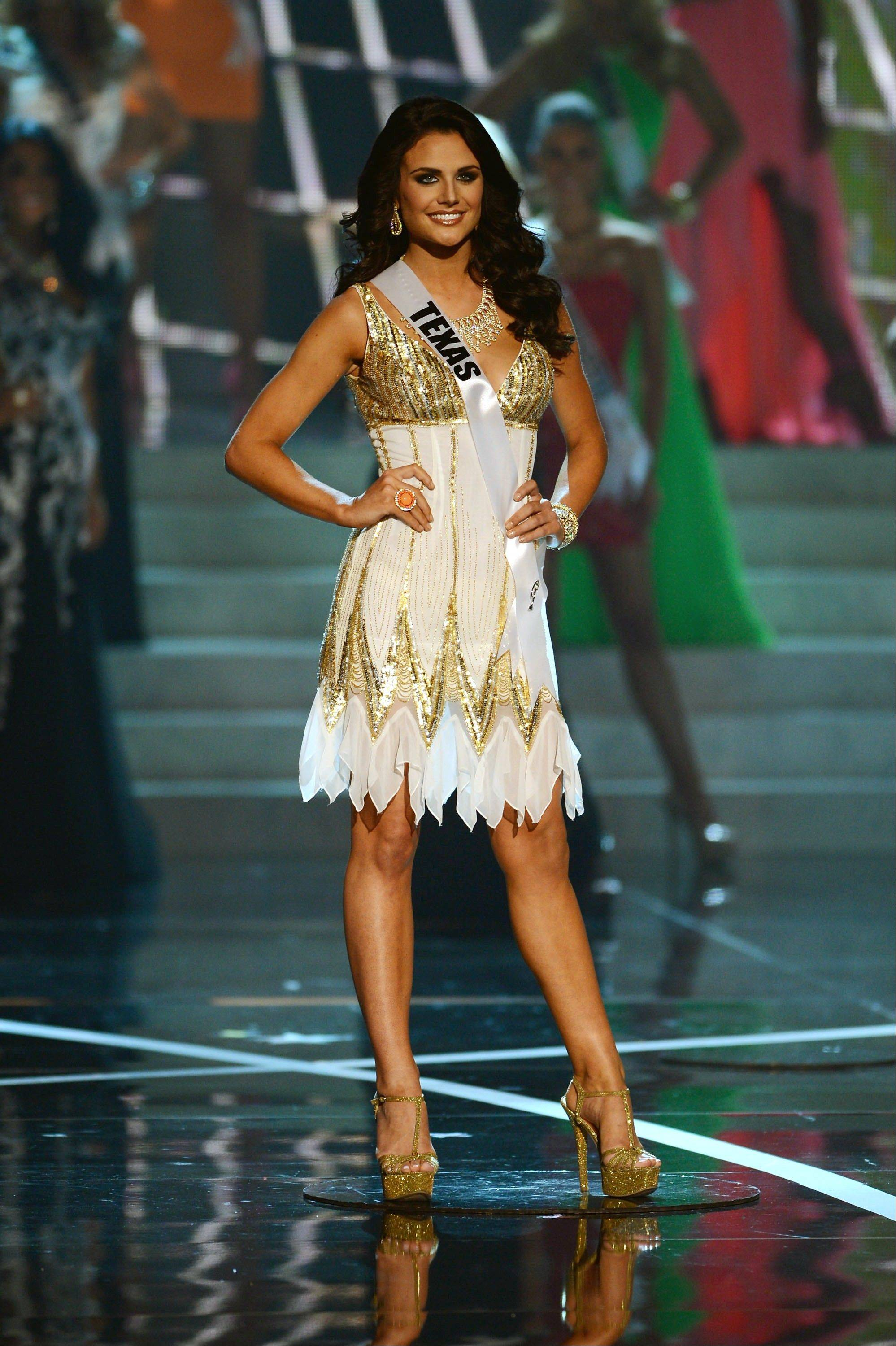 Miss Texas Ali Nugent from Dallas walks the runway during the introductions of the Miss USA 2013 pageant, Sunday, June 16, 2013, in Las Vegas.