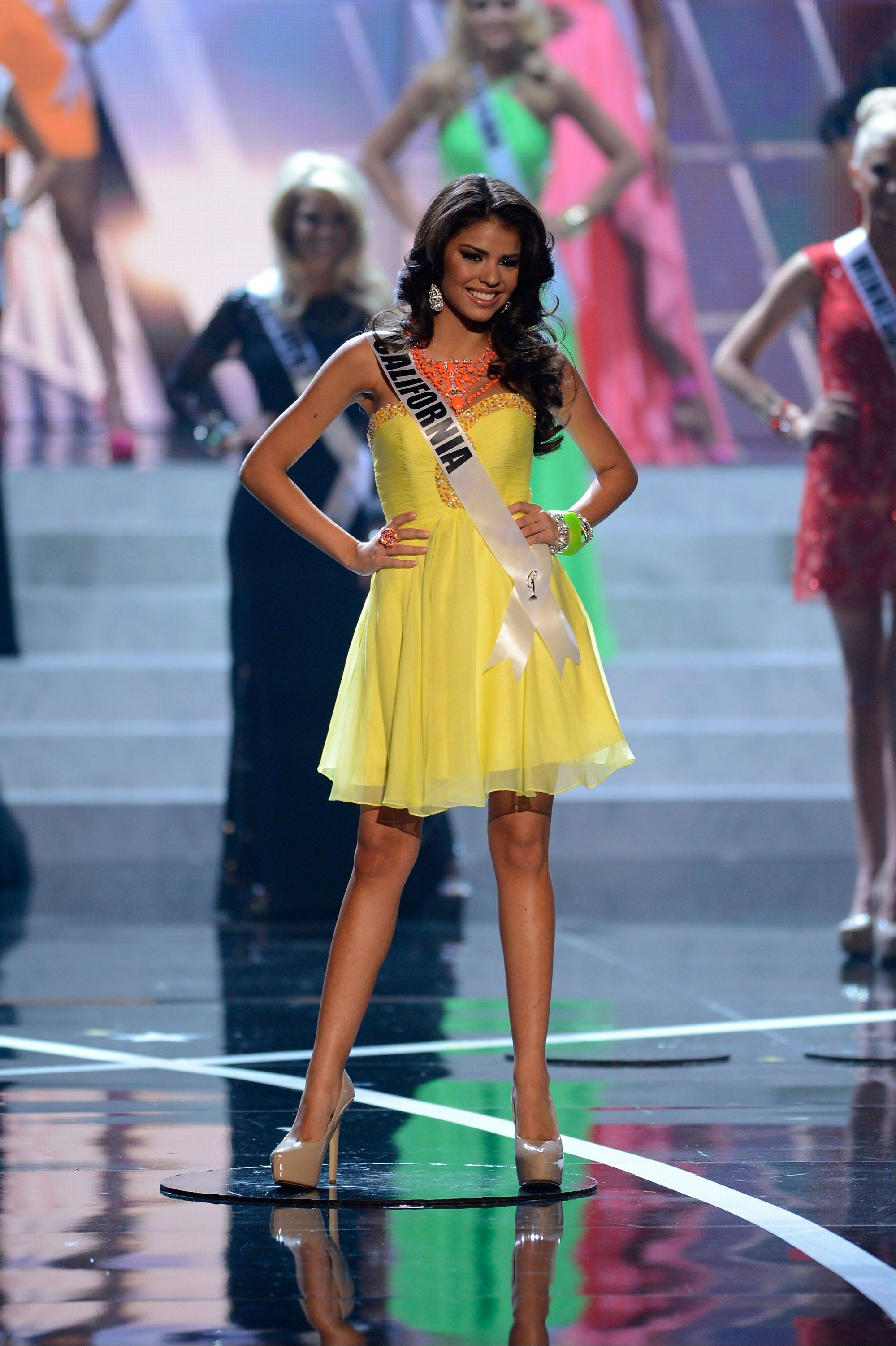 Miss California Mabelynn Capeluj from Wildomar walks the runway during the introductions of the Miss USA 2013 pageant, Sunday, June 16, 2013, in Las Vegas.