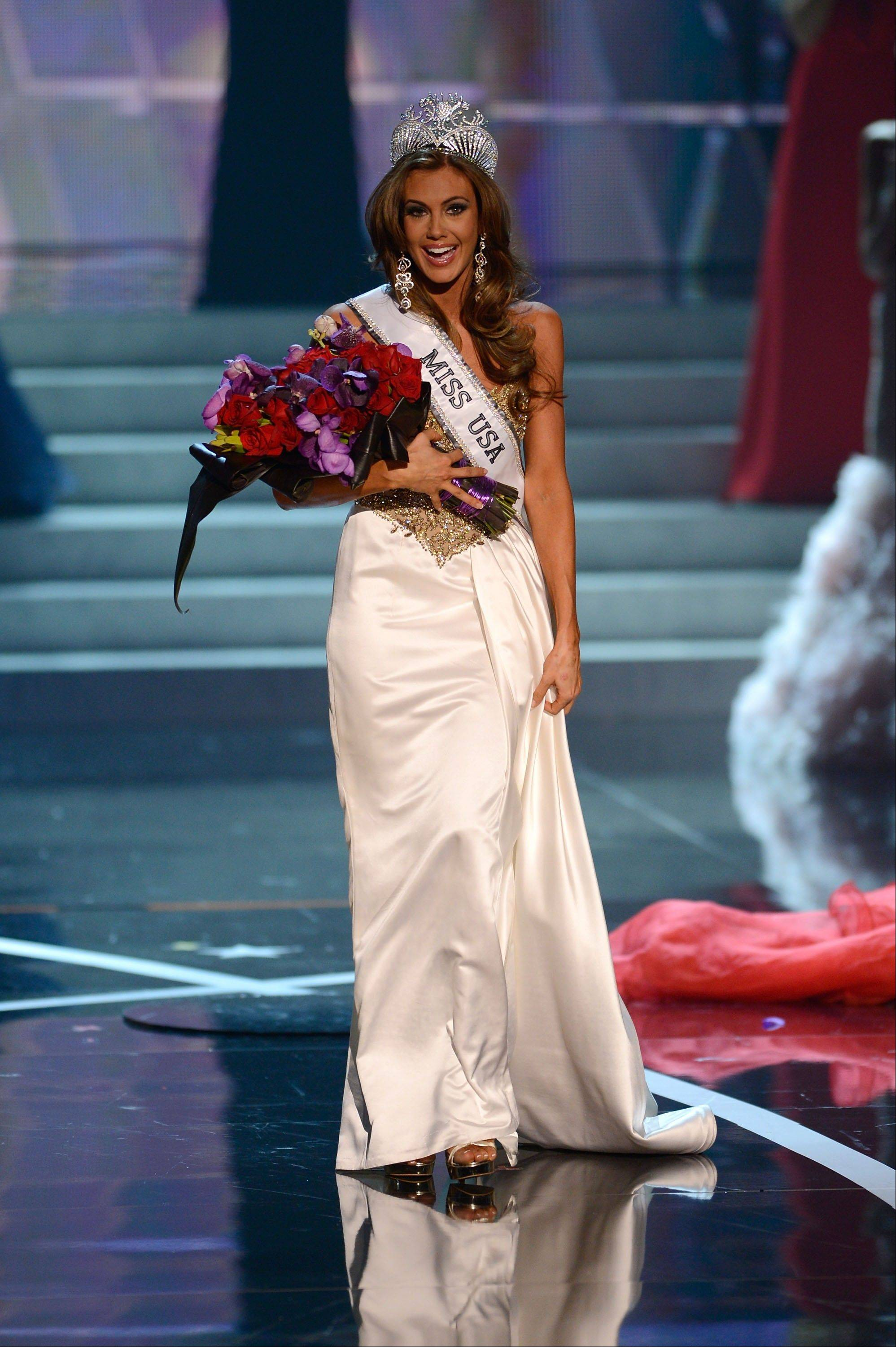 Miss Connecticut Erin Brady reacts after winning the Miss USA 2013 pageant, Sunday, June 16, 2013, in Las Vegas.