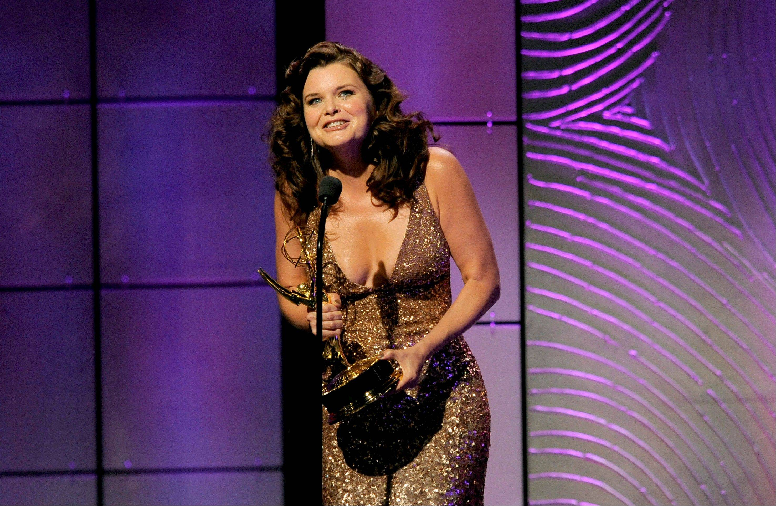 "Heather Tom accepts the award for outstanding lead actress in a drama series for ""The Bold and the Beautiful"" at the 40th Annual Daytime Emmy Awards on Sunday, June 16, 2013, in Beverly Hills, Calif."