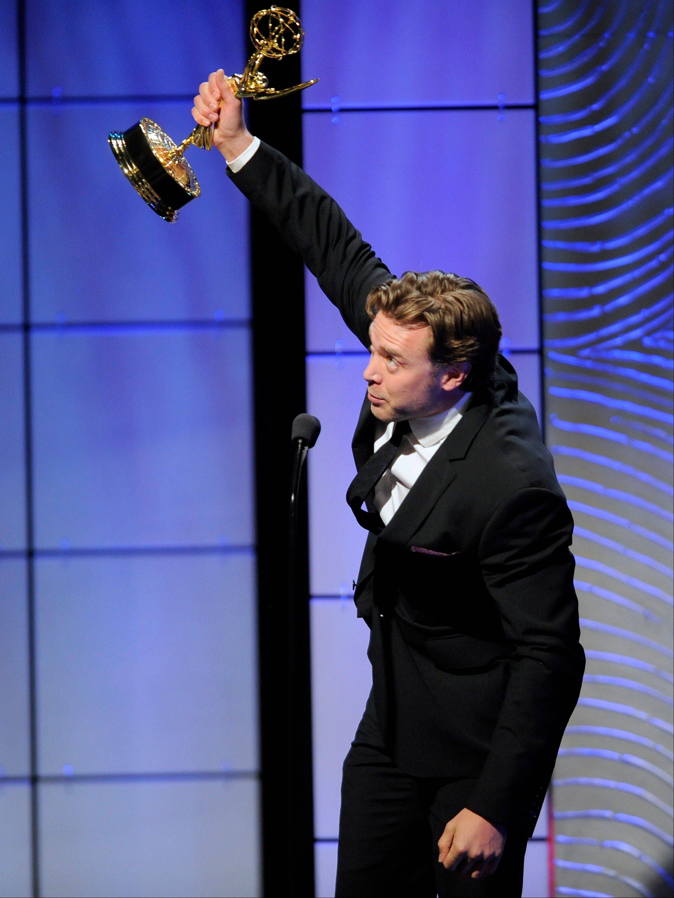 "Billy Miller accepts the award for outstanding supporting actor in a drama series for ""The Young and the Restless"" at the 40th Annual Daytime Emmy Awards on Sunday, June 16, 2013, in Beverly Hills, Calif."