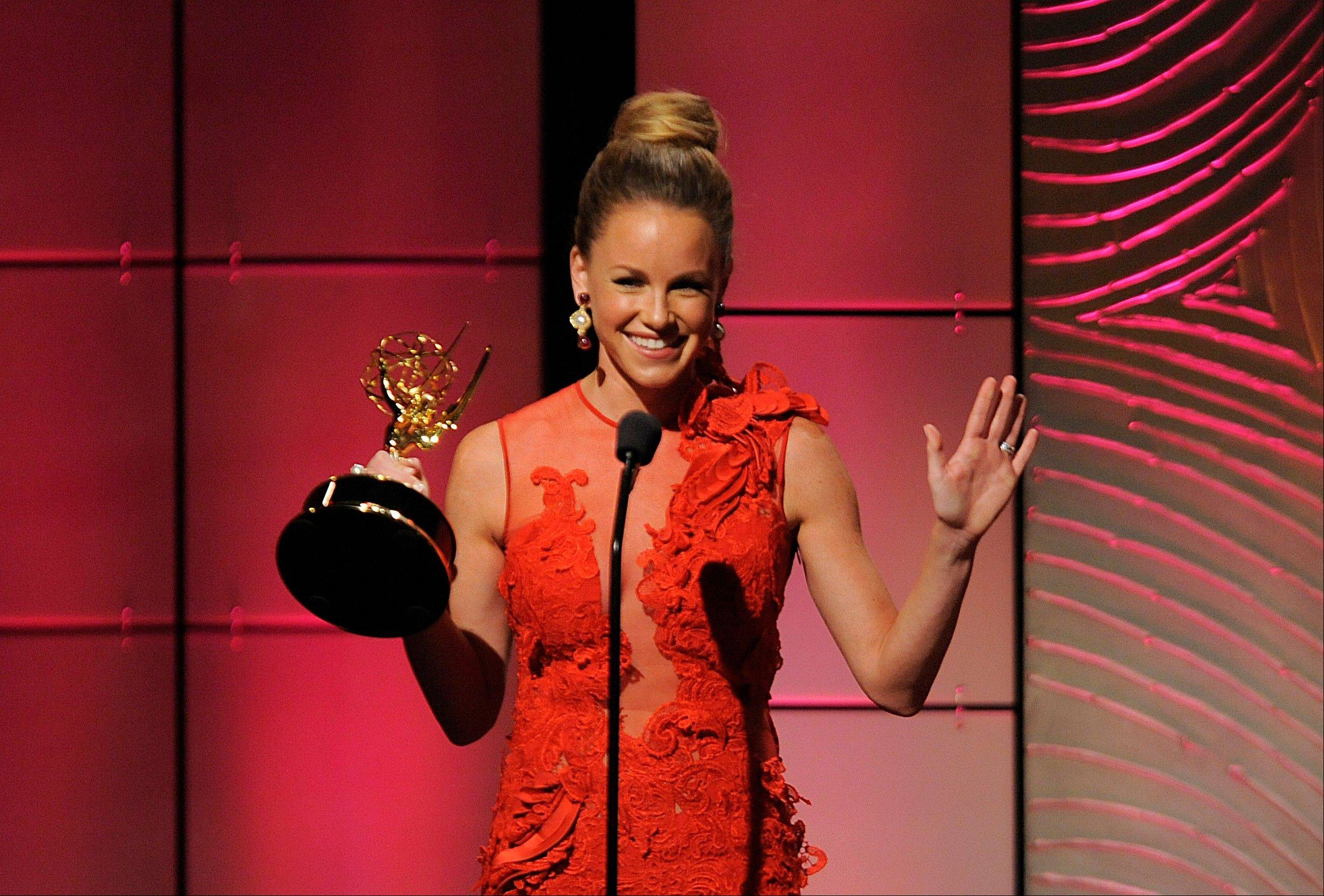 "Julie Marie Berman accepts the award for outstanding supporting actress in a drama series for ""General Hospital"" at the 40th Annual Daytime Emmy Awards on Sunday, June 16, 2013, in Beverly Hills, Calif."