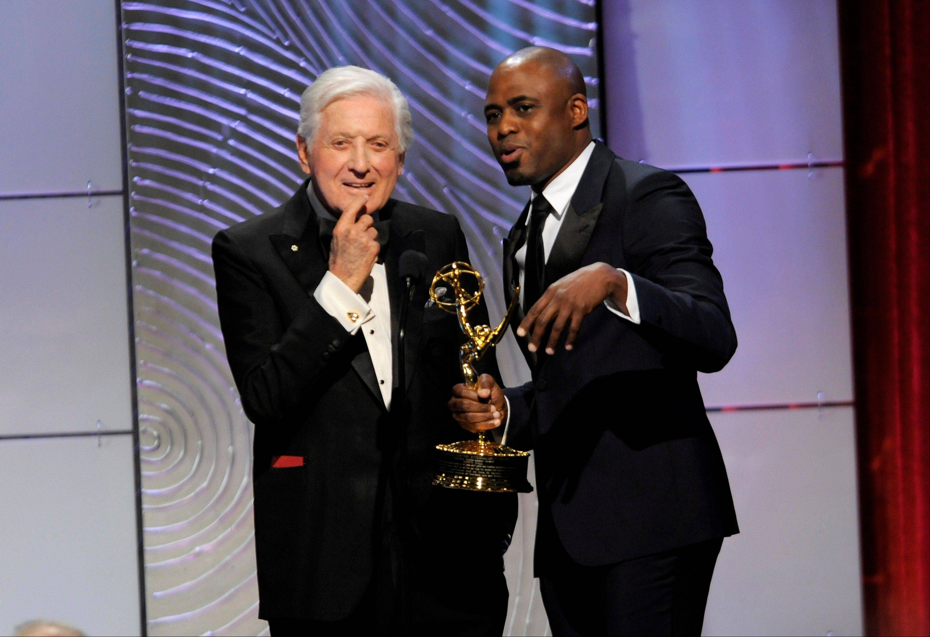Wayne Brady, right, presents the lifetime achievement award to Monty Hall at the 40th Annual Daytime Emmy Awards on Sunday, June 16, 2013, in Beverly Hills, Calif.