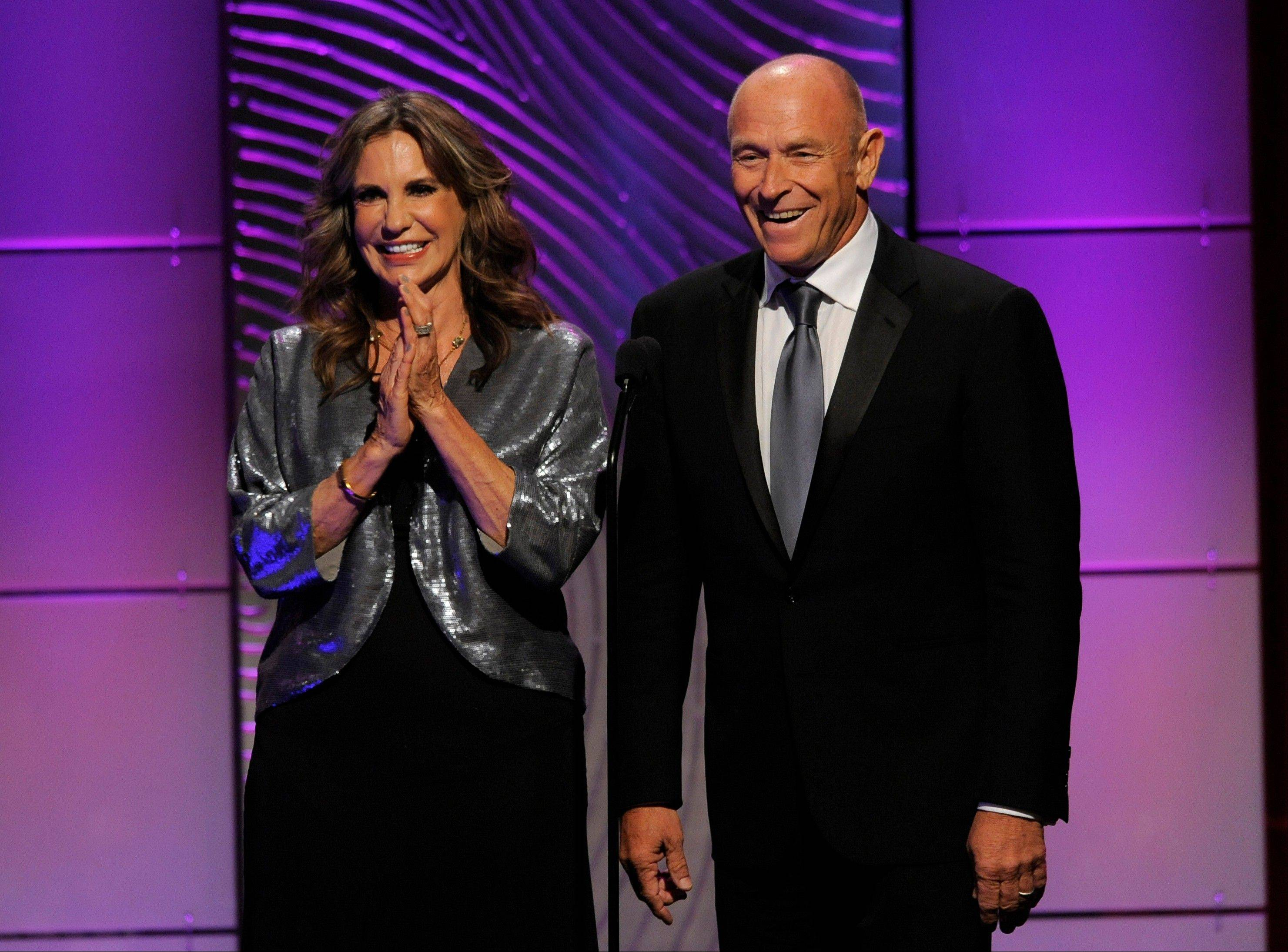 Jess Walton, left, and Corbin Bernsen present an in memoriam tribute at the 40th Annual Daytime Emmy Awards on Sunday, June 16, 2013, in Beverly Hills, Calif.