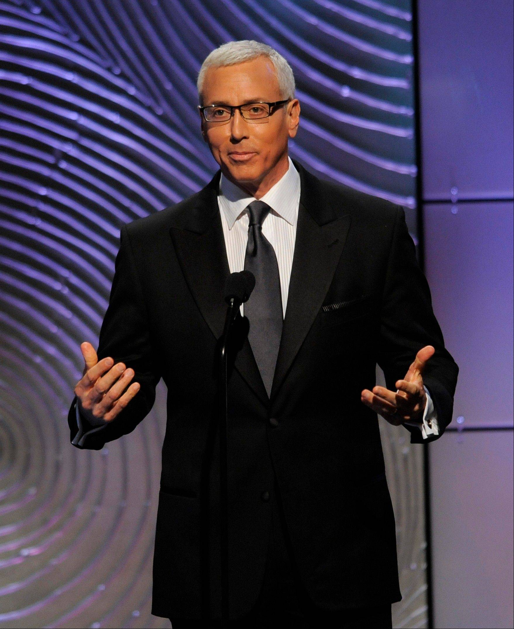 Dr. Drew Pinsky speaks on stage at the 40th Annual Daytime Emmy Awards on Sunday, June 16, 2013, in Beverly Hills, Calif.