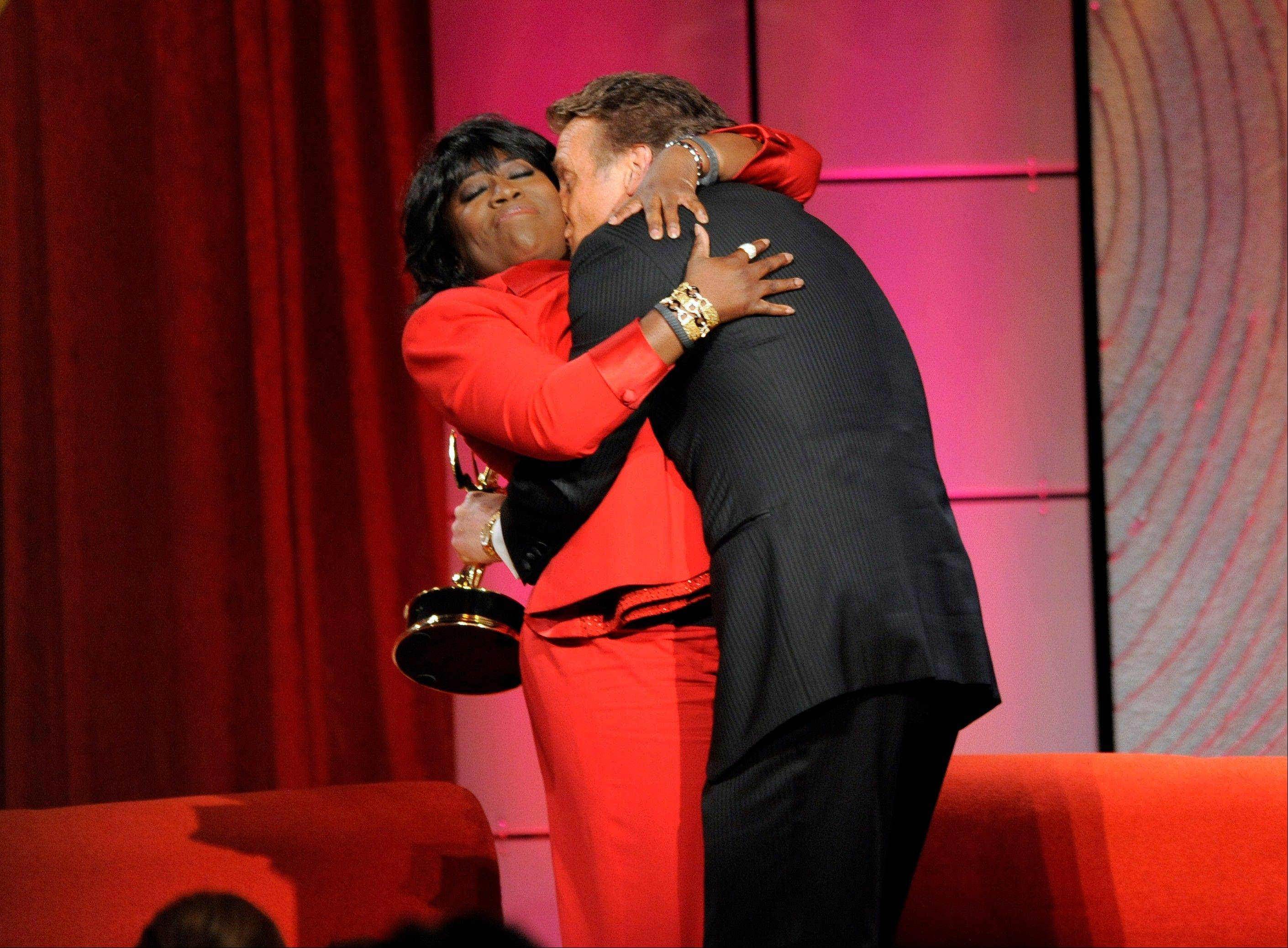 "Sheryl Underwood, left, hugs Doug Davidson, winner of the award for outstanding lead actor in a drama series for ""The Young and the Restless,"" during an onstage interview at the 40th Annual Daytime Emmy Awards on Sunday, June 16, 2013, in Beverly Hills, Calif."