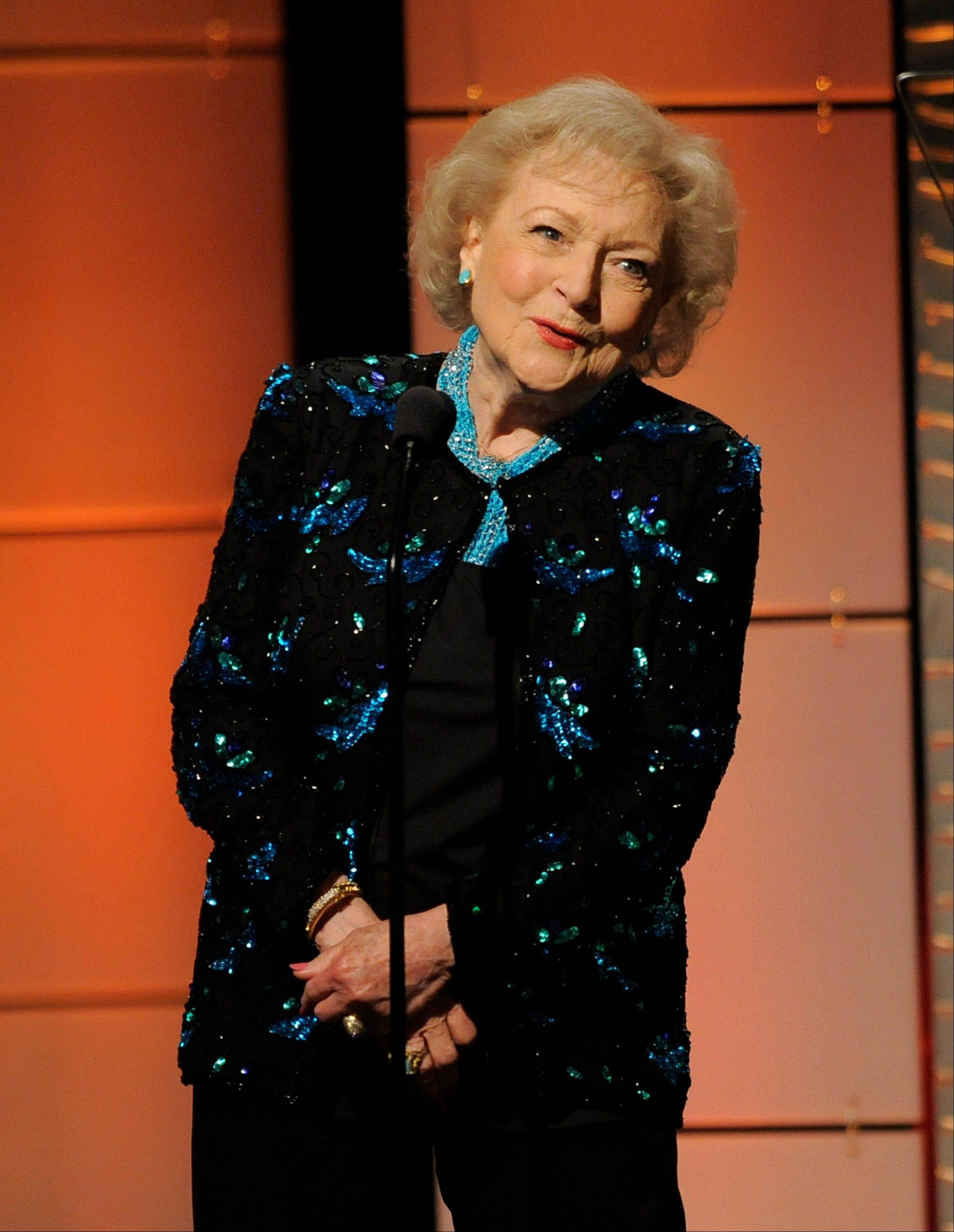 Betty White presents the lifetime achievement award at the 40th Annual Daytime Emmy Awards on Sunday, June 16, 2013, in Beverly Hills, Calif.