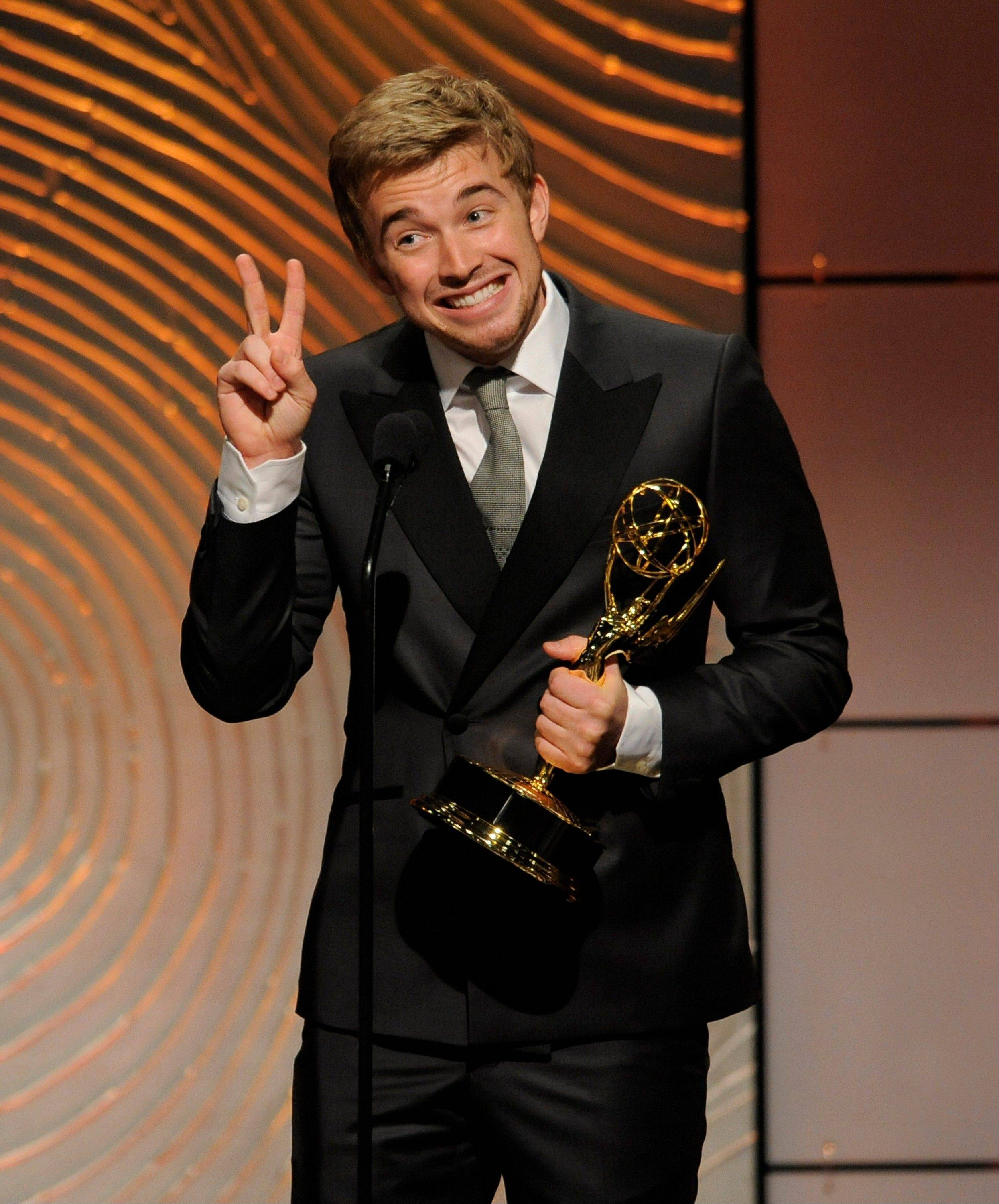 "Chandler Massey accepts the award for outstanding younger actor in a drama series for ""Days of our Lives"" at the 40th Annual Daytime Emmy Awards on Sunday, June 16, 2013, in Beverly Hills, Calif."
