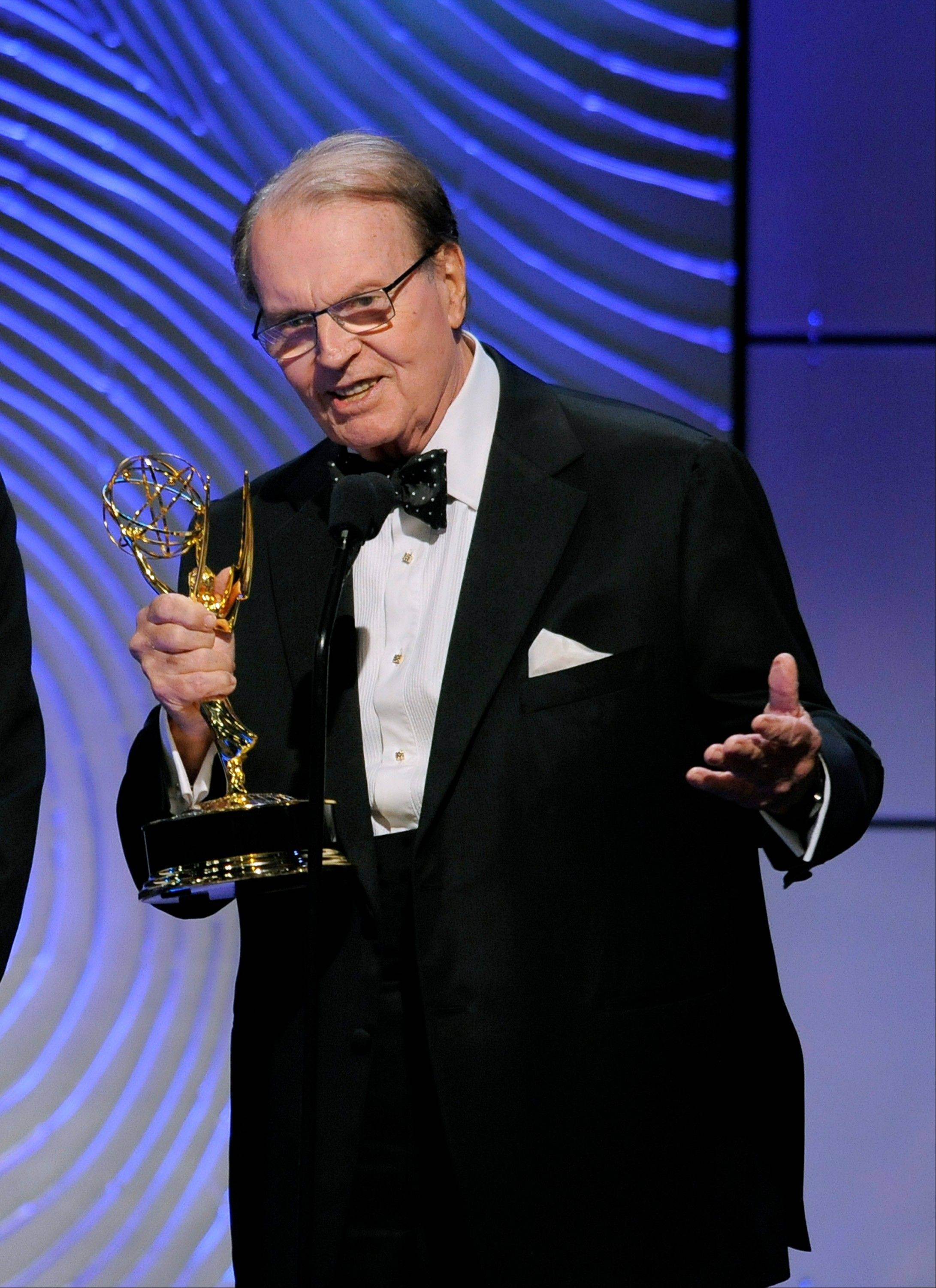 "Charles Osgood accepts the award for outstanding morning program for ""CBS Sunday Morning"" at the 40th Annual Daytime Emmy Awards on Sunday, June 16, 2013, in Beverly Hills, Calif."