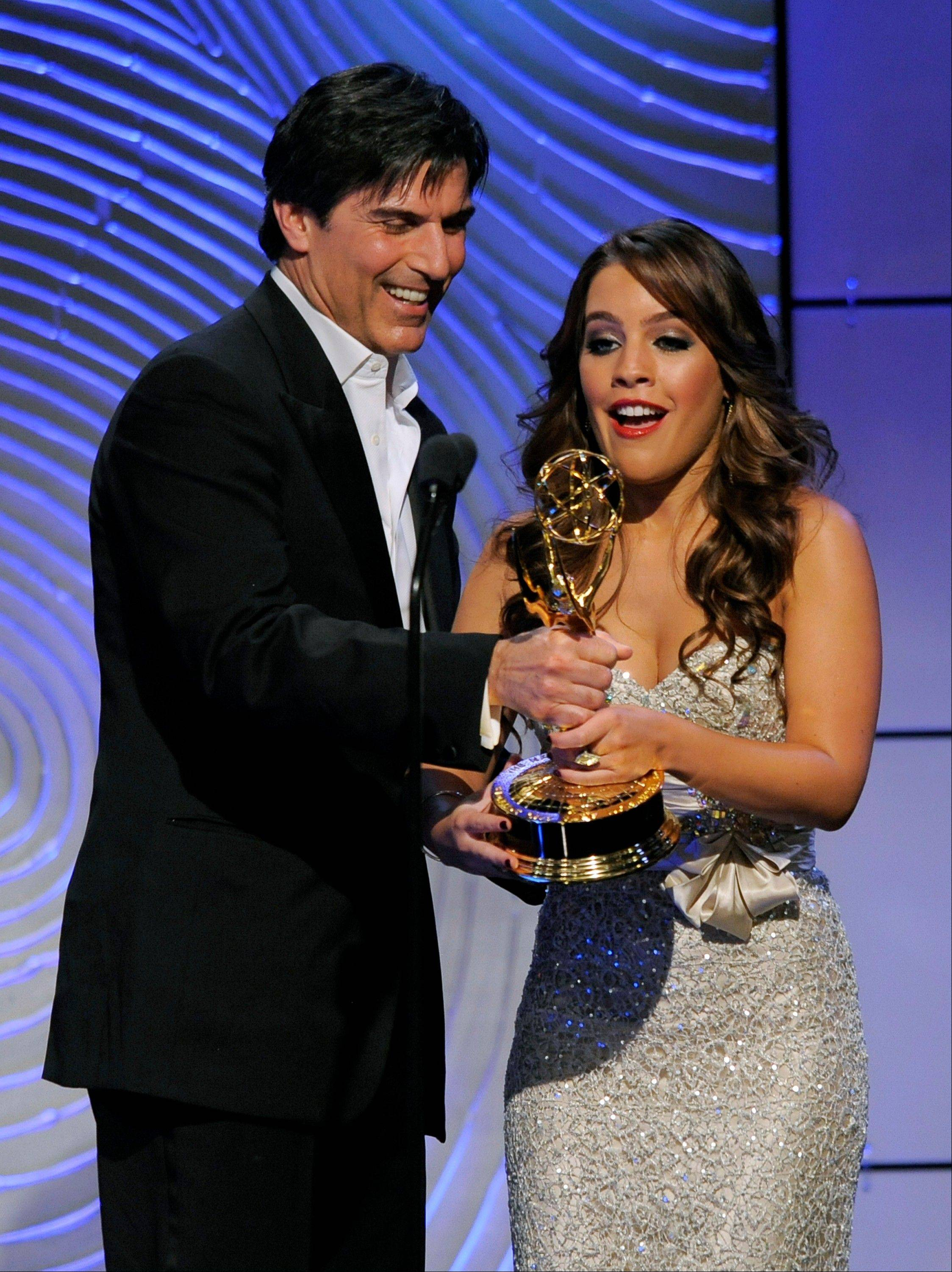 "Vincent Irizarry, left, presents the award for outstanding younger actress in a drama series to Kristen Alderson for ""General Hospital"" at the 40th Annual Daytime Emmy Awards on Sunday, June 16, 2013, in Beverly Hills, Calif."